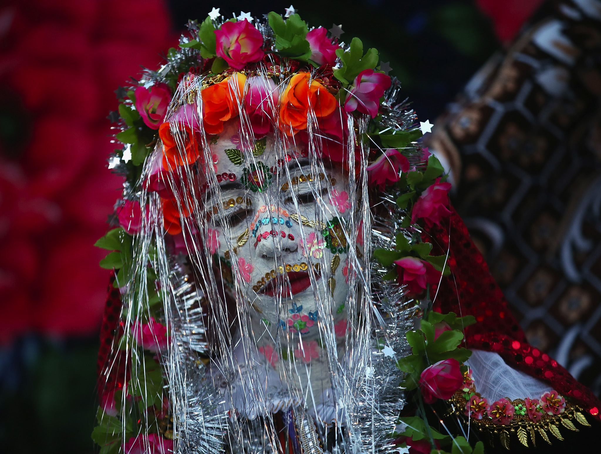 """Bride Fatme Inus, her face painted white and decorated with sequins, emerges to present herself to villagers towards the end of her two-day wedding to Mustafa Sirakov in Ribnovo, Bulgaria. The practice of painting the bride's face white and decorating it with sequins and coloured paint is called """"gelena"""" in Bulgarian, is unique to Ribnovo and is a tradition going back centuries. Ribnovo weddings only take place in the winter and the entire village participates with group dances on the main square. Ribnovo, located in the mountains of southern Bulgaria, is predominantly inhabited by Pomaks, a Muslim ethnic minority who are the descendants of Christian Bulgarians who converted to Islam during Ottoman rule."""