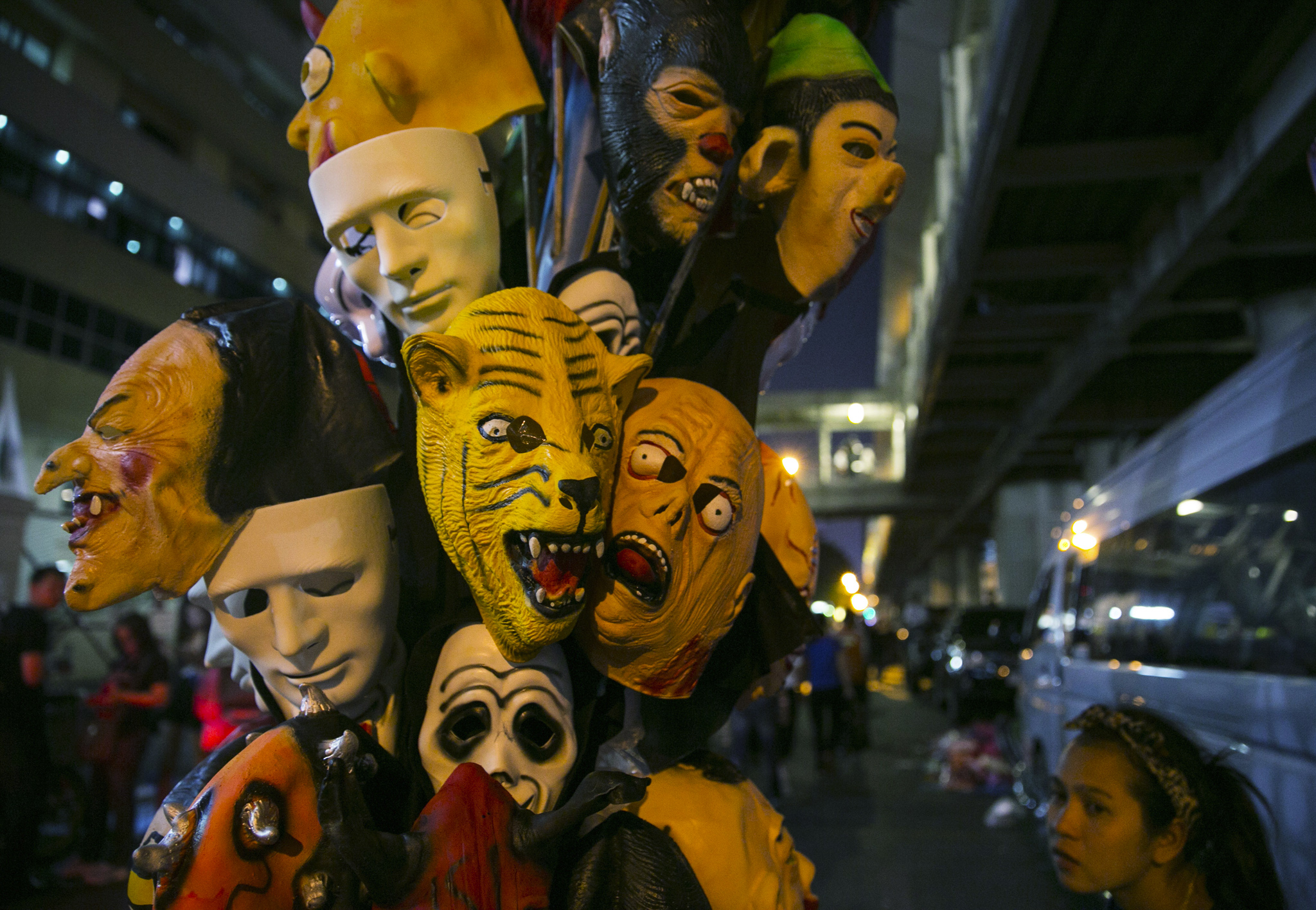 "Masks are displayed for sale at a protest site in downtown Bangkok on the second day of the ""Bangkok Shutdown"" in Thailand."