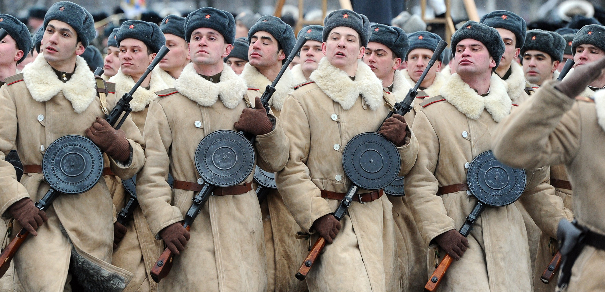Russian soldiers wearing WWII-era Red Army winter clothing march during a military parade to mark the 70th anniversary of the final raise of the Nazi blockade of the city Leningrad, now St. Petersburg. The German and Finnish siege and blockade of Leningrad was broken on January 18, 1943 but finally lifted a year after, on January 27, 1944.