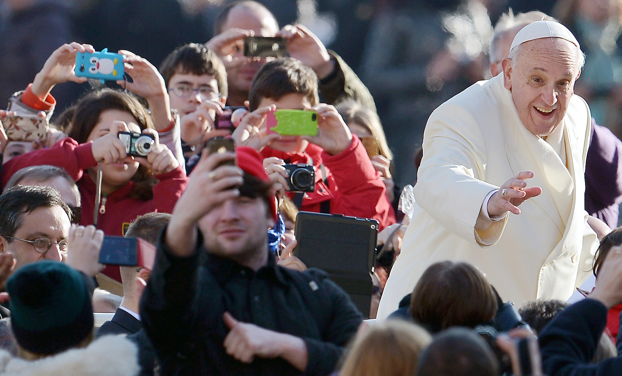 Pope Francis waves to faithfulls as he a...Pope Francis waves to faithfulls as he arrives at St Peter's Square at the Vatican to lead his weekly general audience on January 8, 2014.   AFP PHOTO/ Gabriel BOUYSGABRIEL BOUYS/AFP/Getty Images