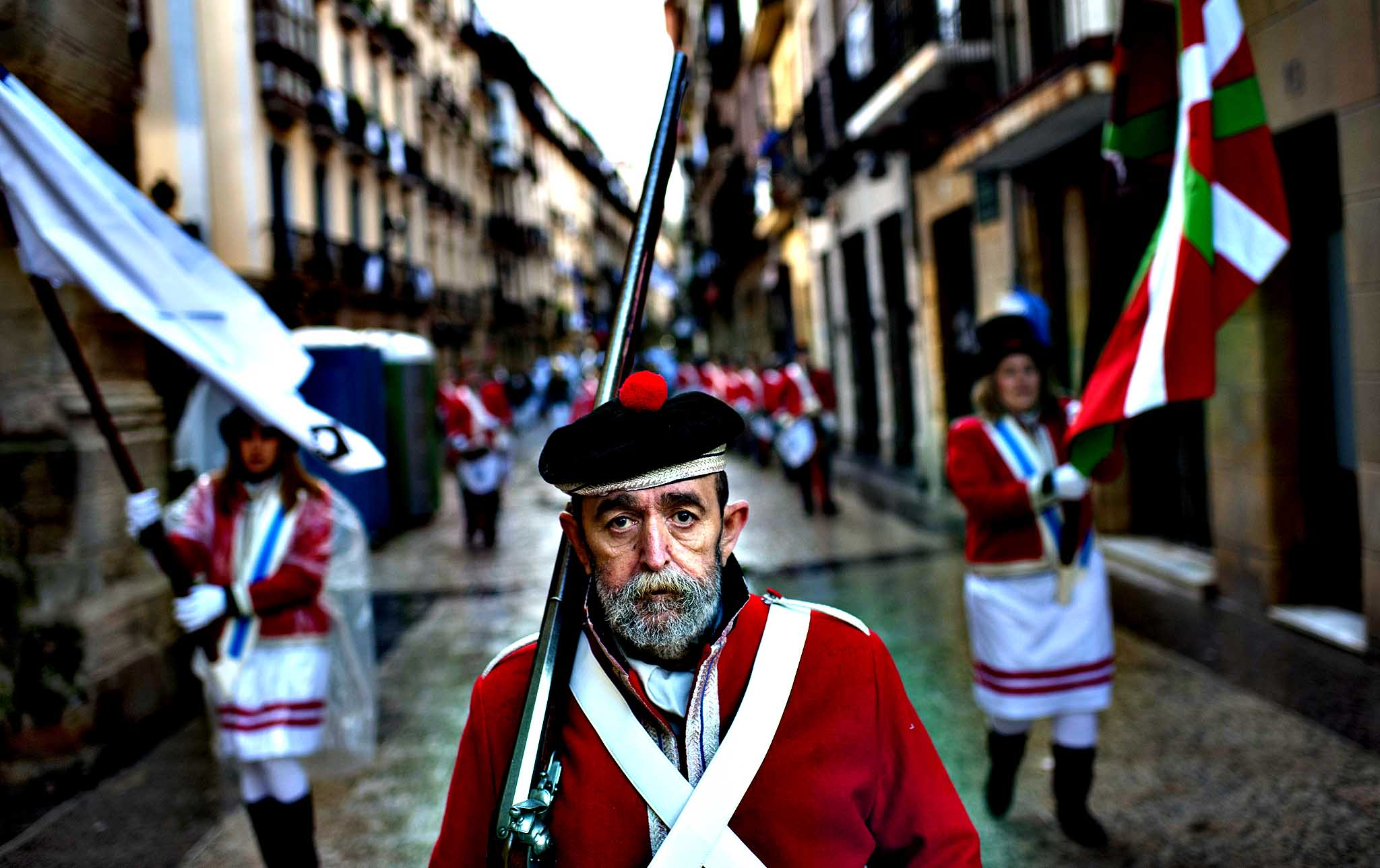 A ''Tamborillero'' wearing his uniform takes part in the traditional ' La Tamborrada', during 'El Dia Grande', the main day of San Sebastian feasts, in the Basque city of San Sebastian, northern Spain, Monday, Jan. 20, 2014. From midnight,  companies of perfectly uniformed marchers parade through the streets of San Sebastian playing drums and barrels in honor of their patron saint.