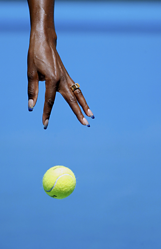 Blue-tipped fingernails of Williams of the U.S. are seen as she bounces the ball to serve during her women's singles match against Makarova of Russia at the Australian Open 2014 tennis tournament in Melbourne...The blue-tipped fingernails of Venus Williams of the U.S. are seen as she bounces the ball to serve during her women's singles match against Ekaterina Makarova of Russia at the Australian Open 2014 tennis tournament in Melbourne January 13, 2014. REUTERS/Jason Reed