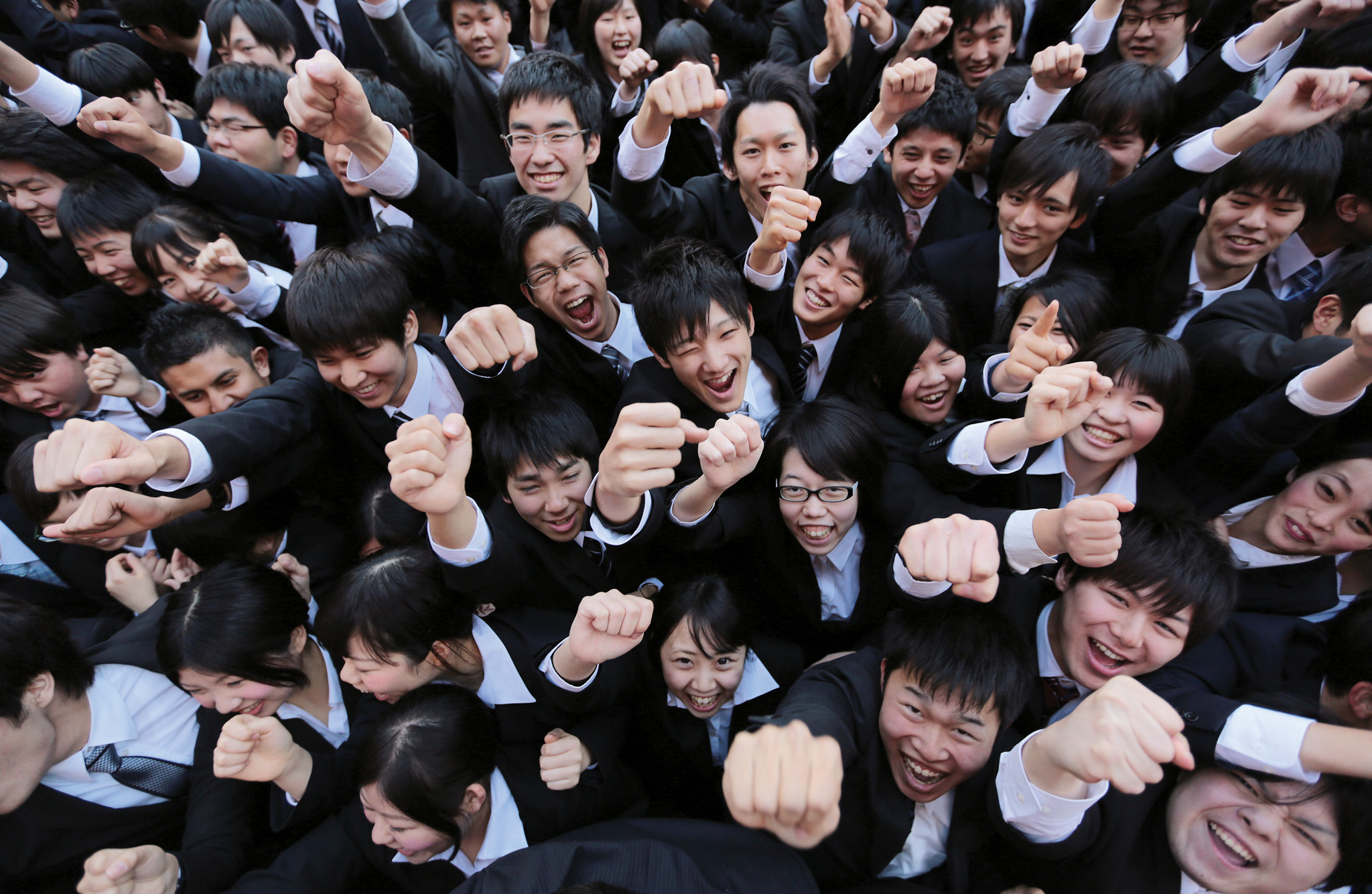 Vocational Students Attend Pep Rally Ahead Of Job Hunting...Vocational school students raise their fists during a rally to start off job-hunting in Tokyo, Japan, on Wednesday, Jan. 29, 2014. Japan's jobless rate held at 4 percent in October, and the number of positions on offer for every 100 people seeking work rose to 98, the highest level since 2007 -- a sign of tightening in the job market that could put upward pressure on wages.