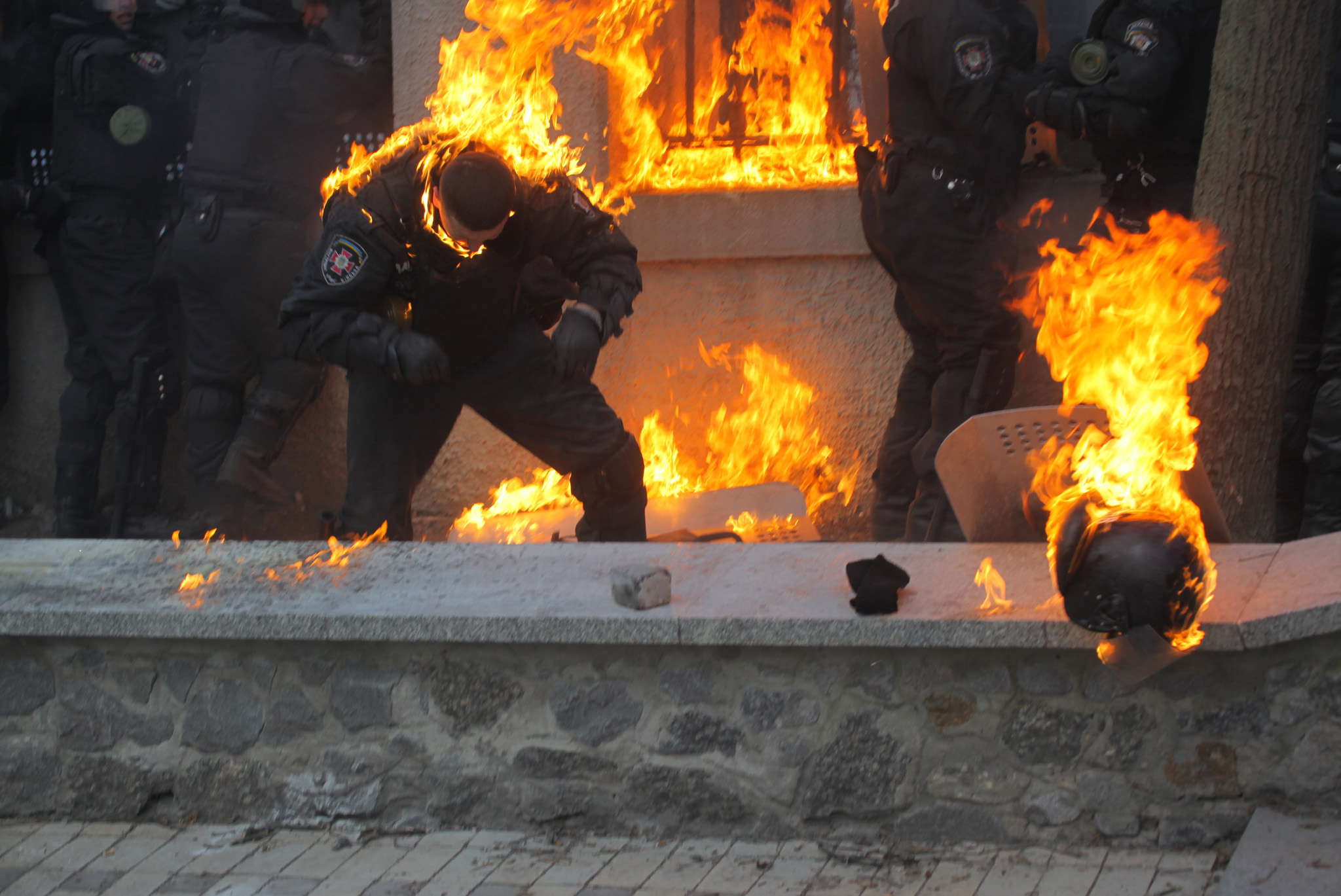 Anti-government protests in Ukraine...  KIEV, UKRAINE - JANUARY 20:  This handout photo released by Ukrainian Ministry of Internal Affairs shows burning members of the Ukrainian riot police due to the gasoline bombs hurled by anti-government protestors during the clashes in central Kiev, Ukraine, January 20, 2014. At least 61 people were admitted to hospital and 100 police officers wounded after violent clashes broke out when thousands marched on Kiev's streets to demonstrate against a recently passed anti-protest legislation. (Photo by Ukrainian Ministry of Internal Affairs/Anadolu Agency/Getty Images)