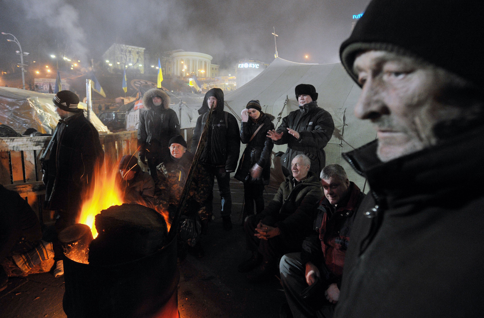 "TOPSHOTS Ukrainian pro-EU protesters kee...TOPSHOTS Ukrainian pro-EU protesters keep warm around a bonfire in Independence Square in Kiev early on January 17, 2014. The European Union and the United States expressed concern after the Ukrainian parliament passed laws to curb the right to protest, a move the opposition called a power grab.  Western rights groups meanwhile denounced the bills as an attempt by President Viktor Yanukovych to impose a ""dictatorship"" and called on him to veto the legislation. AFP PHOTO/GENYA SAVILOVGENYA SAVILOV/AFP/Getty Images"