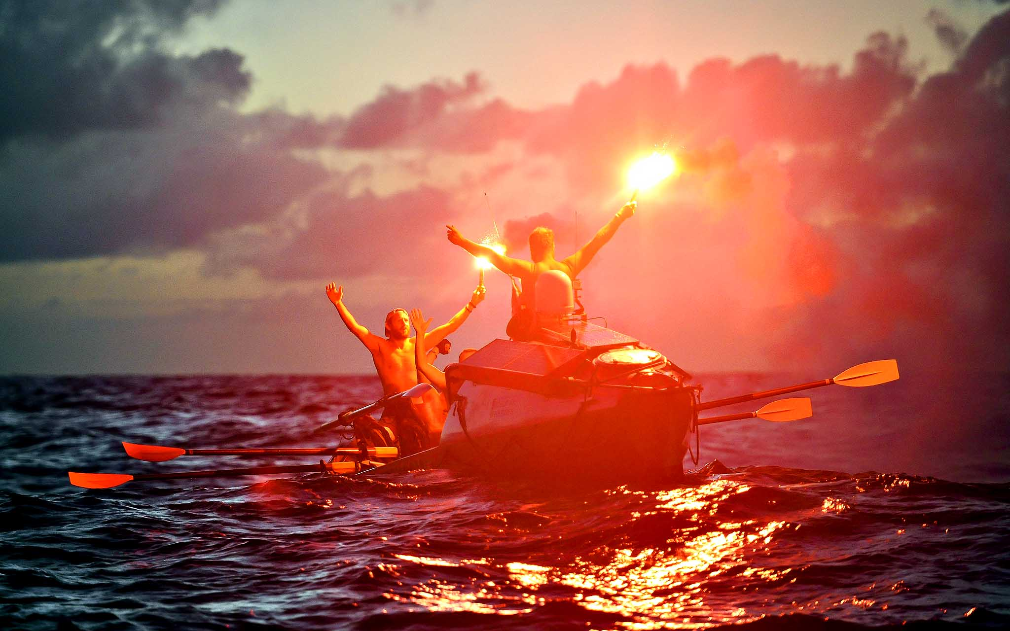 The Row2Recovery Team, made up of four British soldiers, light flares as they cross the finish line off the coast of the Caribbean island of Antigua after rowing across the Atlantic Ocean. PRESS ASSOCIATION Photo. Issue date: Wednesday January 22, 2014.