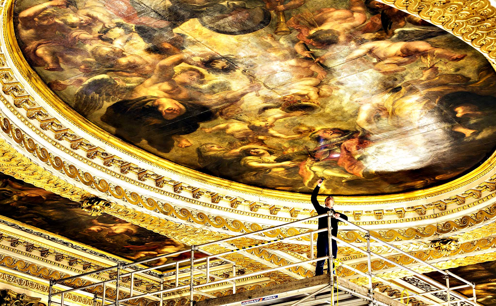 Preventive conservation co-ordinator at Historic Royal Palaces Jonathan Bridal inspects the Rubens ceiling paintings for damage during a conditioning survey at Banqueting House on January 21, 2014 in London, England. Flemish artist Sir Peter Paul Rubens painted the nine oil canvases for Charles I, they were installed in the hall in 1636. The three main canvasses depict The Union of the Crowns, The Apotheosis of James I and The Peaceful Reign of James I, since their creation, the paintings have undergone at least 14 restoration treatments including mounting the canvases permanently onto plywood boards in 1907. For the first time Historic Royal Palaces has taken paint samples of the coffering to determine past colour schemes.
