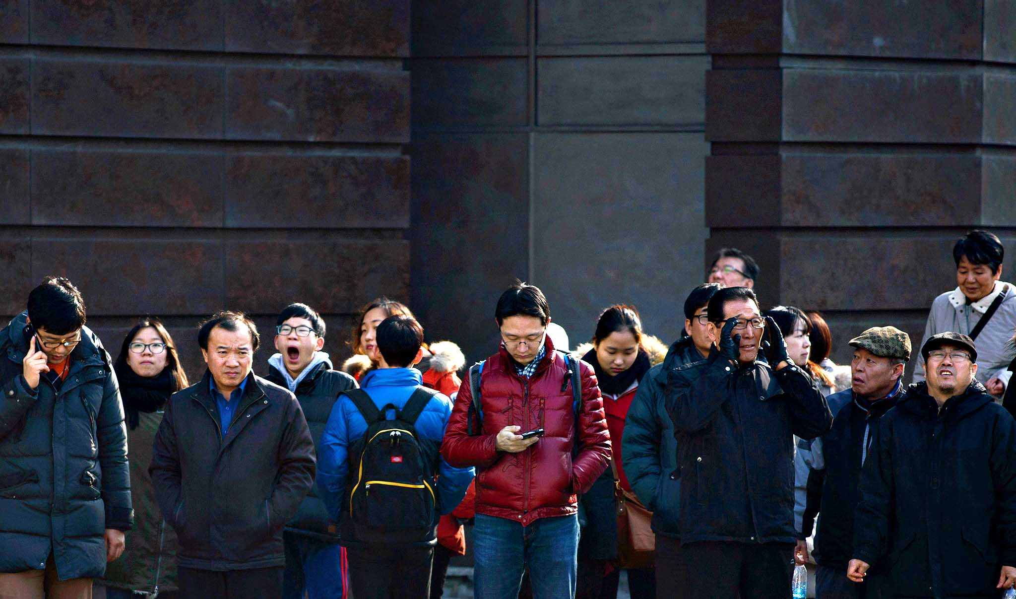 Pedestrians wait to cross a street in Seoul on January 27, 2014. South Korea's economy grew at a slightly slower 0.9 percent in the fourth quarter of last year, as falling construction investments offset a rise in exports, state data showed January 23.