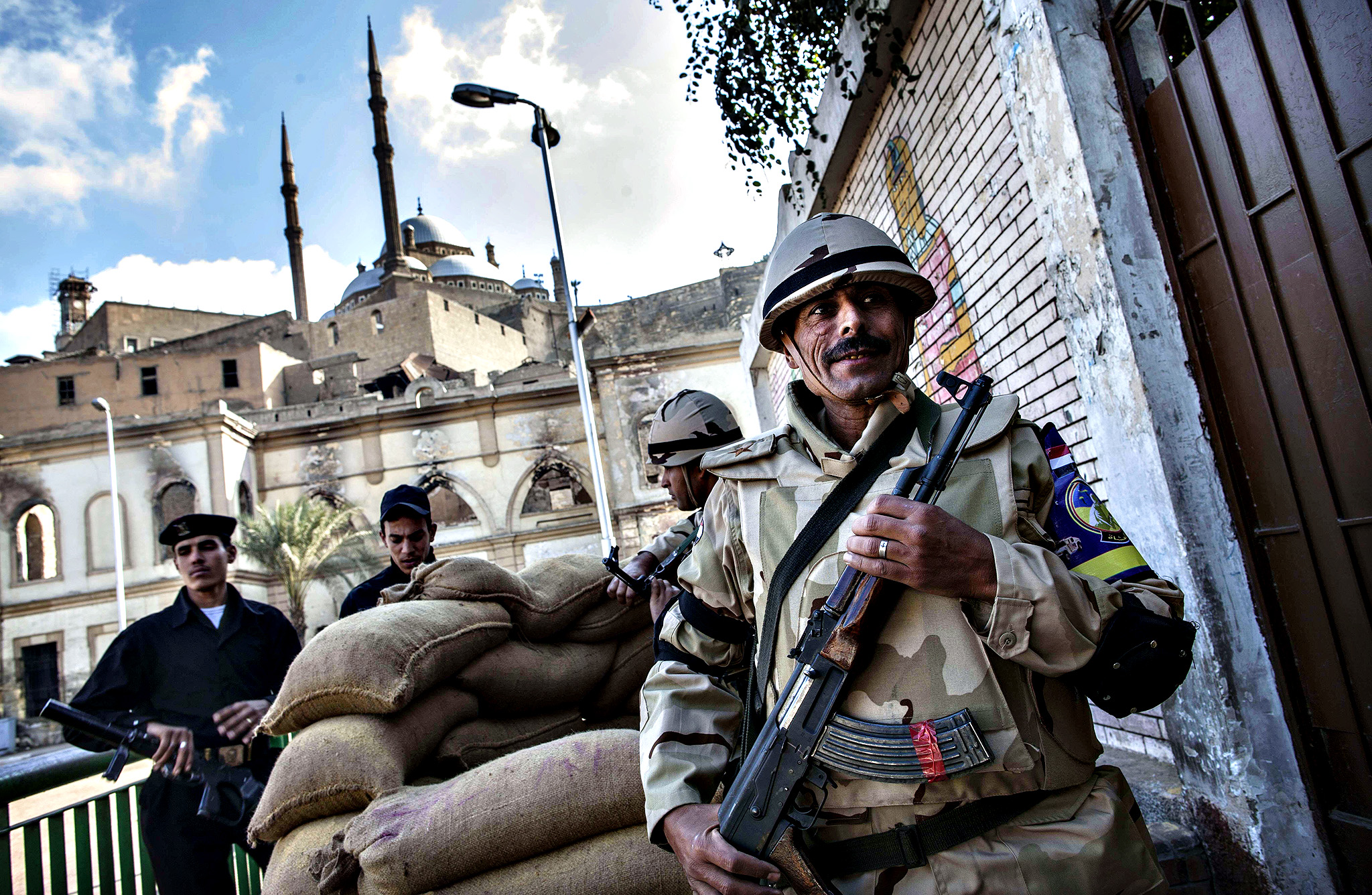 Members of the Egyptian security forces stand guard outside a polling station near The Saladin Citadel (background) on Mokattam hill near the center of Cairo during the second day of voting on a new constitution on January 15, 2014. Egyptians resumed voting in the constitutional referendum, with turnout expected to hold the key to a likely presidential bid by army chief Abdel Fattah al-Sisi after clashes killed nine the previous day.