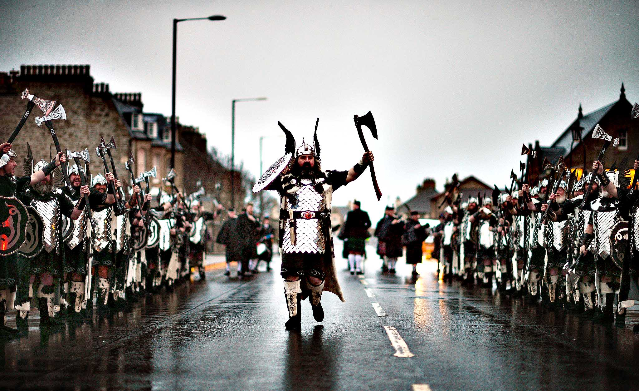 Locals dressed as Vikings  march through the streets of Lerwick on January 28, 2014, in the Shetland Islands, Scotland. The traditional festival of fire is known as 'Up Helly Aa'. The spectacular event takes place annually on the last Tuesday of January. The climax of the day comes with participants in full costume hauling a Viking longboat through the streets of Lerwick to the edge of town where up to 1000 people parade and throw their flaming torches into the galley.