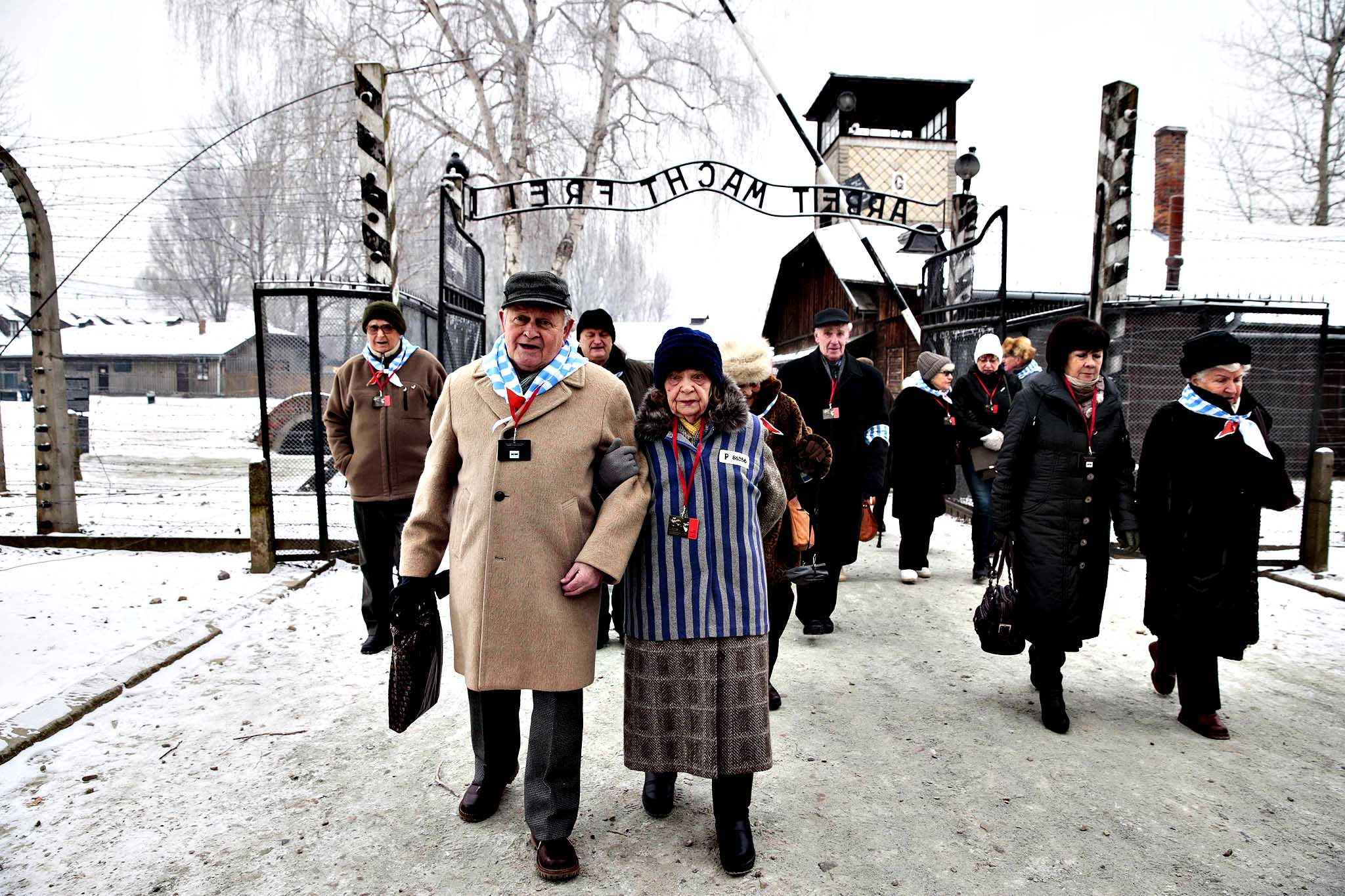 Holocaust survivors arrive for a ceremony to mark the 69th anniversary of the liberation of Auschwitz concentration camp and to remember the victims of the Holocaust in Auschwitz...Holocaust survivors arrive for a ceremony to mark the 69th anniversary of the liberation of Auschwitz concentration camp and to remember the victims of the Holocaust in Auschwitz January 27, 2014. The world marks International Holocaust Remembrance Day on January 27 to remember those who died during the Nazi organised genocide during World War Two that cost the lives of millions of Jews, Roma and Sinti, homosexuals and opponents to Germany's fascist regime and its collaborators.
