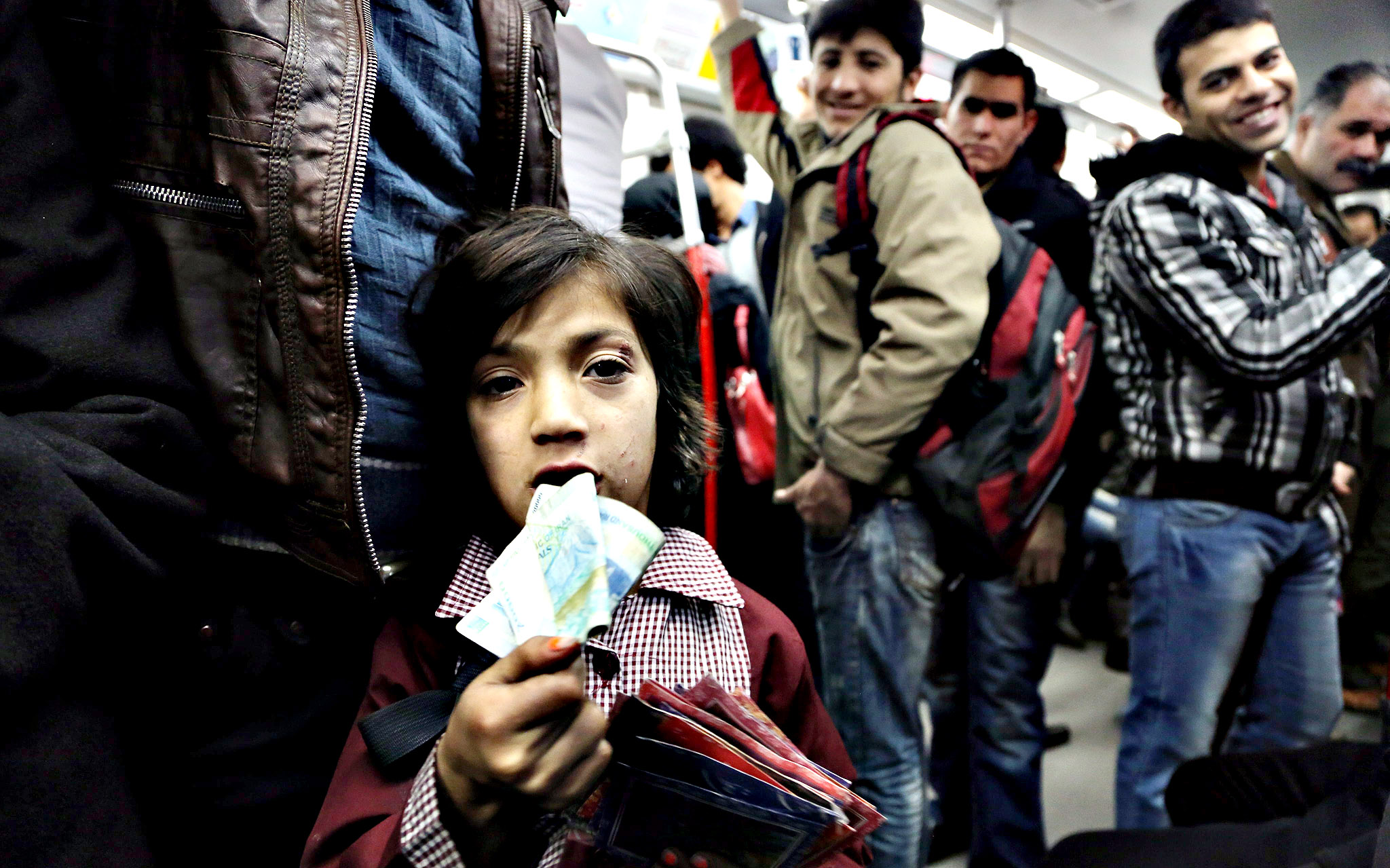 Mona, an Iranian girl, sells fortune papers in a subway in Tehran, Iran, 07 January 2014. International sanctions against Iran in connection with the country's controversial nuclear programmes have led the country into an economic crisis, forcing even children helping out their families as street vendors.