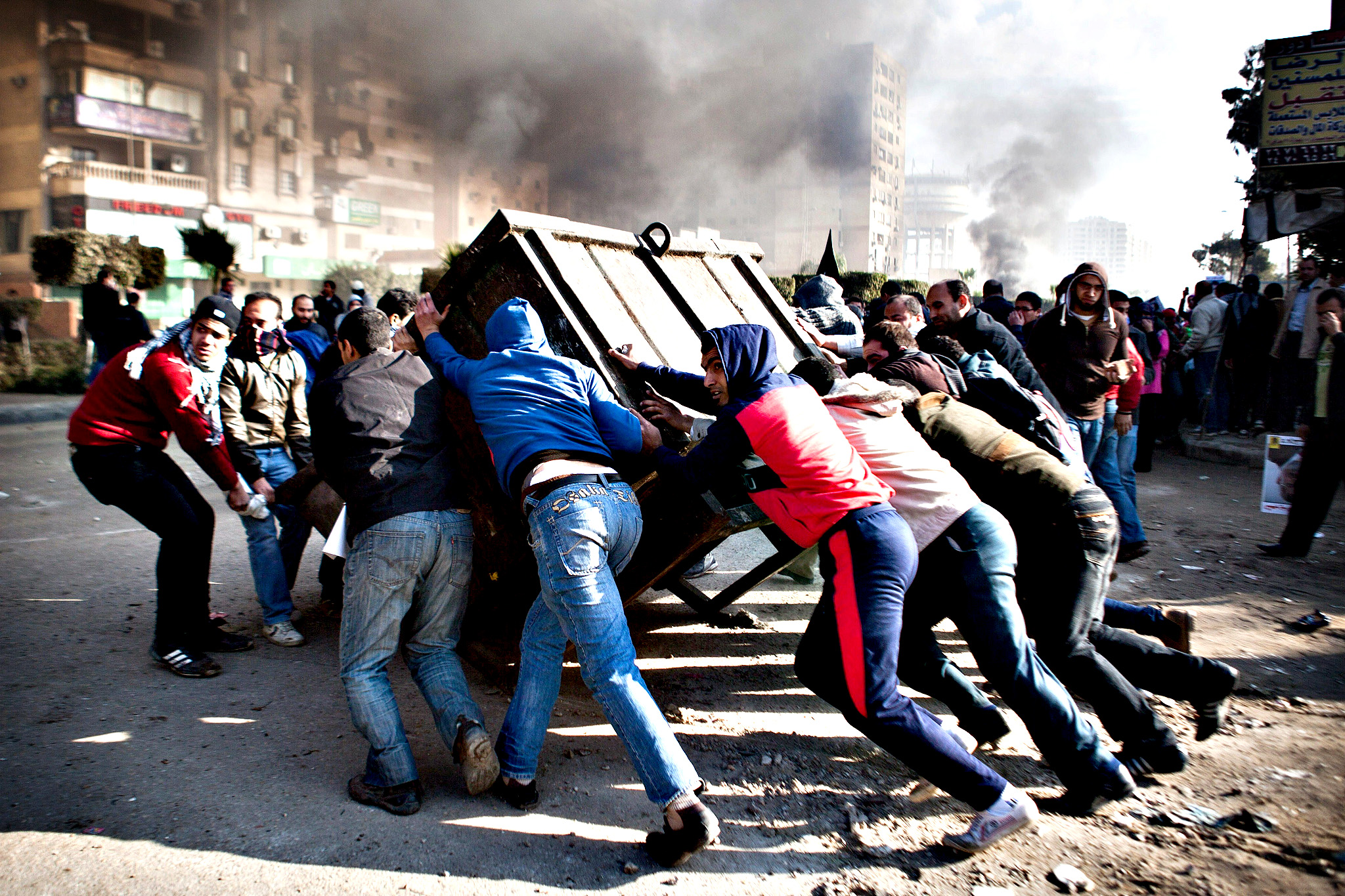 "Supporters of ousted president Mohamed Morsi block a street during clashes with Egyptian security forces in Nasr City, Cairo on January 8, 2014. An Egyptian court adjourned the murder trial of deposed president  Morsi to February 1, citing ""weather conditions"" that prevented the Islamist's transport to court from prison."