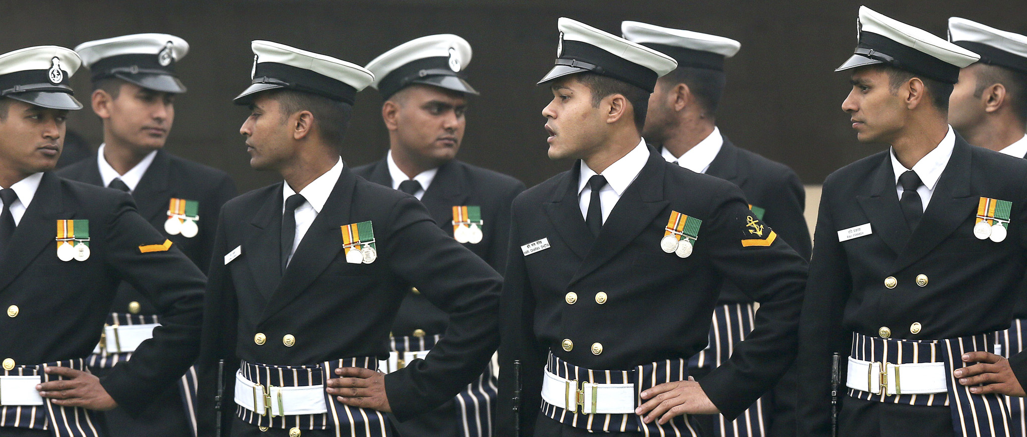 Indian navy sailors participate at a function to pay respect at Rajghat, the memorial of Mahatma Gandhi, on his death anniversary in New Delhi, India, Monday, Jan. 30, 2014. The day when Gandhi was shot and killed in 1948 by Nathuram Godse, a Hindu extremist, is marked as Martyrs' Day in the country.