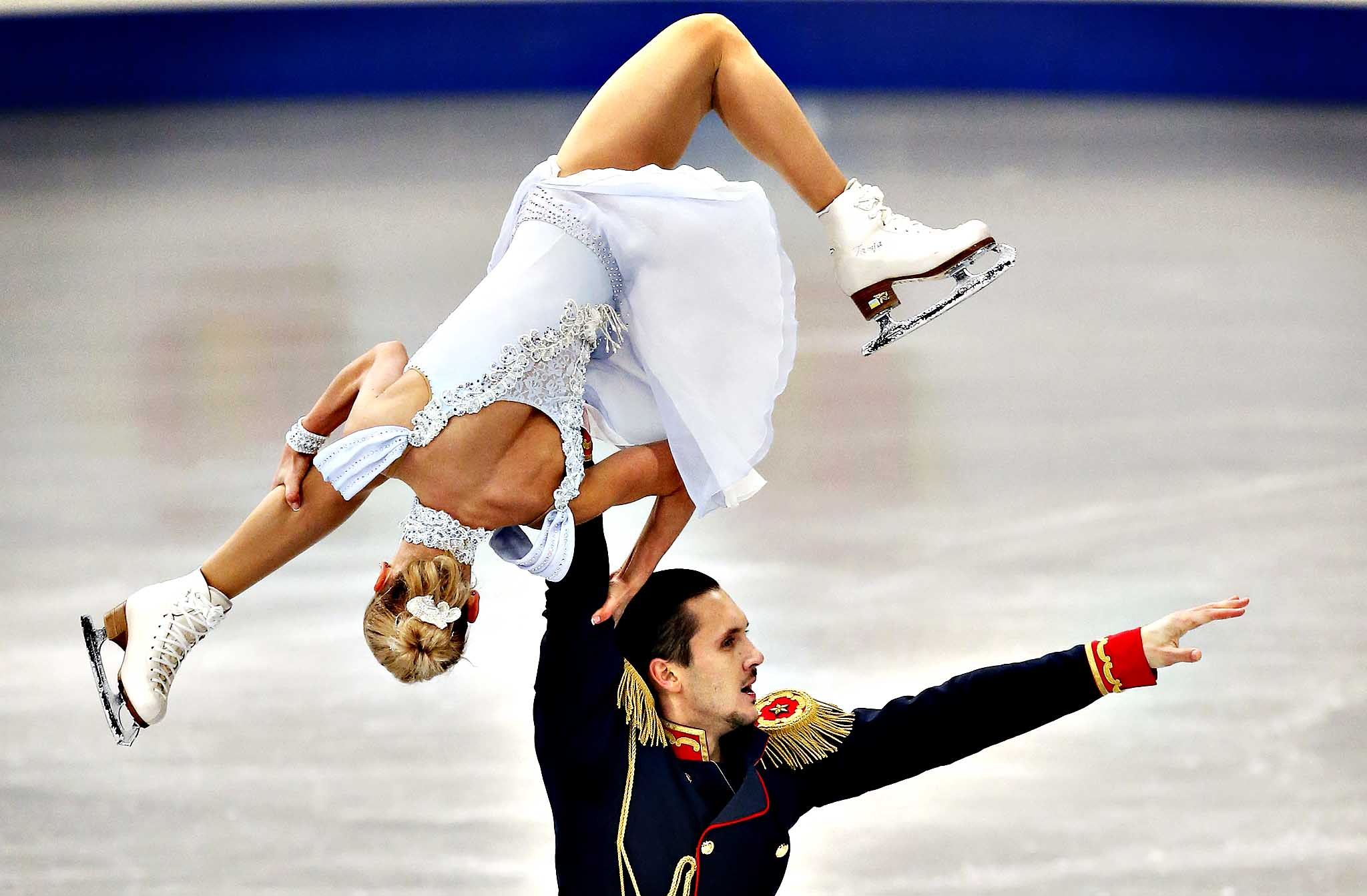 Russia's Tatiana Volosozhar and Maxim Trankov perform in the pairs short program at the European Figure Skating Championships in Budapest, Hungary, Friday, Jan. 17, 2014.
