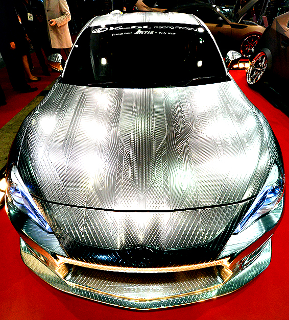 The 3D-custom-painted Toyota 86 by ARTIS company's Takahiko Izawa is displayed at the Kuhl Racing Factory booth during the Tokyo Auto Salon 2014 exhibition at the Makuhari Messe in Chiba on January 10, 2014. Almost 400 domestic and foreign companies participated in the three-day-long custom car exhibition with almost 800 vehicles on display.