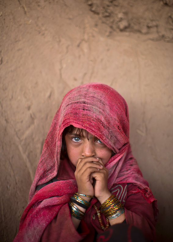 "An Afghan refugee, Hamagai Akbar, 5, attends an event on the occasion of U.N. World Day Of Social Justice, at a makeshift school set up in a mosque on the outskirts of Islamabad, Pakistan, Thursday, Feb. 20, 2014. According to the U.N. website, the occasion aims to support efforts for ""poverty eradication, the promotion of full employment and decent work, gender equity and access to social well-being and justice for all."" (AP Photo/Muhammed Muheisen)"