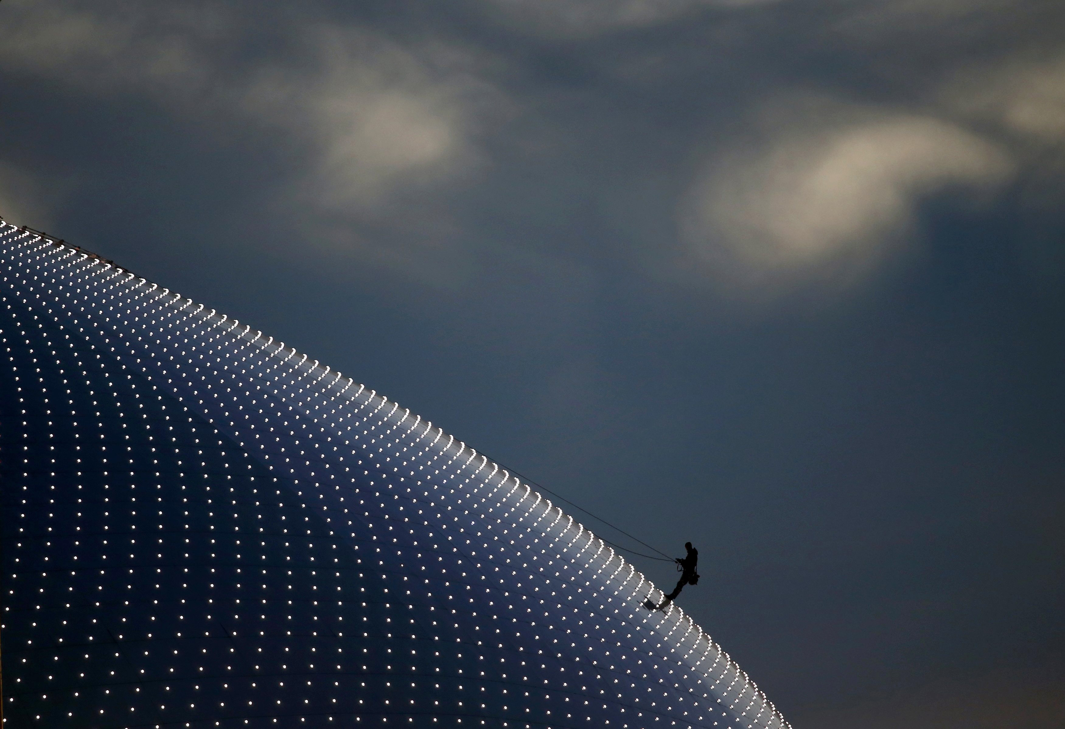 Person climbs on the Bolshoi Dome, one of the ice hockey venues, before the medals ceremony during the 2014 Sochi Winter Olympics...A person climbs on the Bolshoi Dome, one of the ice hockey venues, before the medals ceremony during the 2014 Sochi Winter Olympics February 14, 2014.   REUTERS/Marko Djurica (RUSSIA  - Tags: SPORT OLYMPICS)