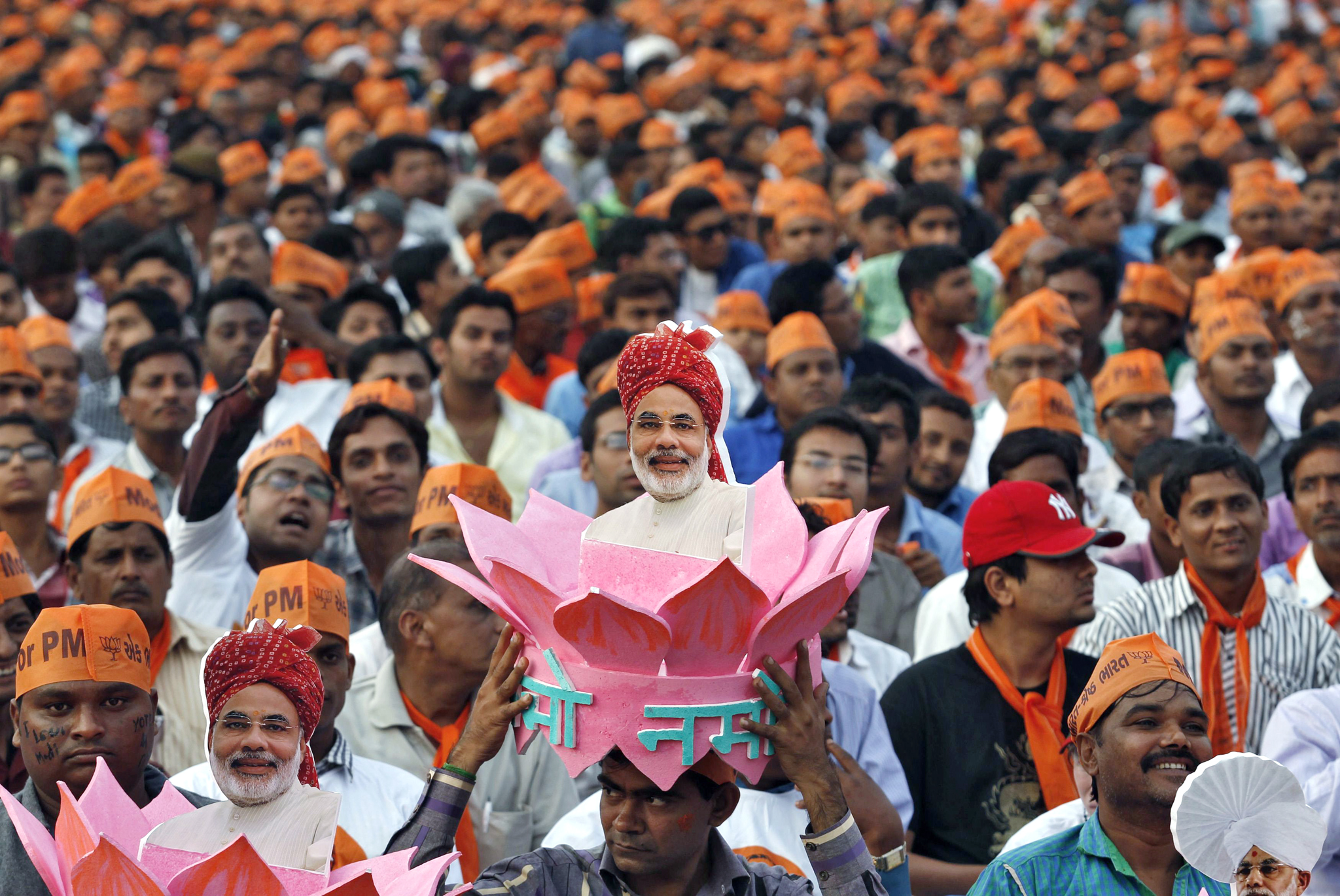 A supporter of Narendra Modi, the prime ministerial candidate for Bharatiya Janata Party, wears a headgear with a portrait of Modi during a rally in Ahmedabad...A supporter of Gujarat's chief minister and Hindu nationalist Narendra Modi, the prime ministerial candidate for India's main opposition Bharatiya Janata Party (BJP), wears a headgear with a portrait of Modi during a rally being addressed by Modi ahead of the 2014 general elections, in the western Indian city of Ahmedabad February 20, 2014. REUTERS/Amit Dave