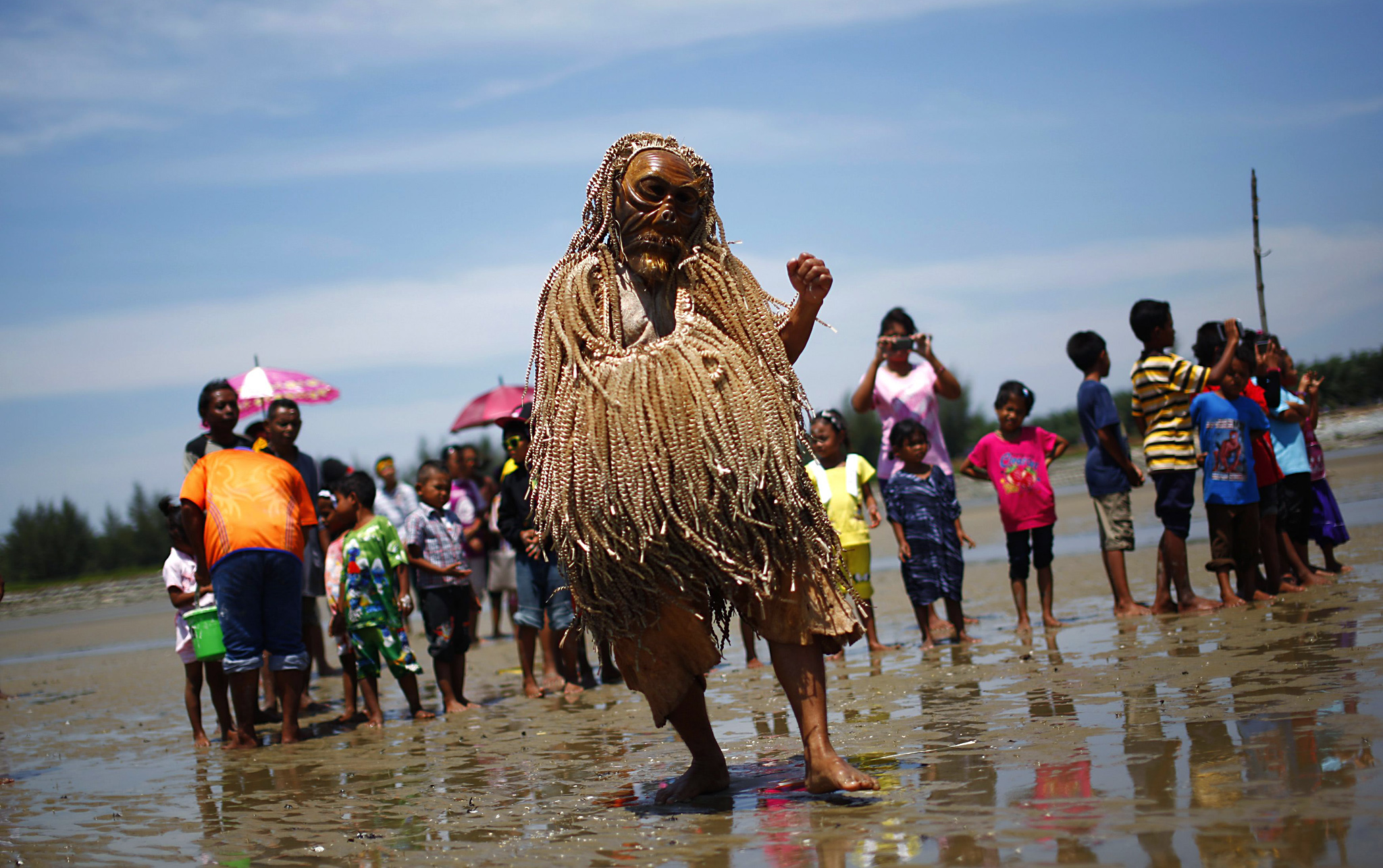 "Members of Malaysia's indigenous Mah Meri tribe perform the ""Main Jo-oh"" dance during a thanksgiving ritual in the village of Pulau Carey...Members of Malaysia's indigenous Mah Meri tribe perform the ""Main Jo-oh"" dance during ""Puja Pantai"", a thanksgiving ritual to appease the spirits of the seas, in the village of Pulau Carey, outside Kuala Lumpur February 4, 2014.The Mah Meri tribe, who are descendants of seafaring people who lived off the sea through fishing and trading, celebrate their new year on February 4 this year according to the lunar calendar, by making offerings to the sea. REUTERS/Samsul Said"