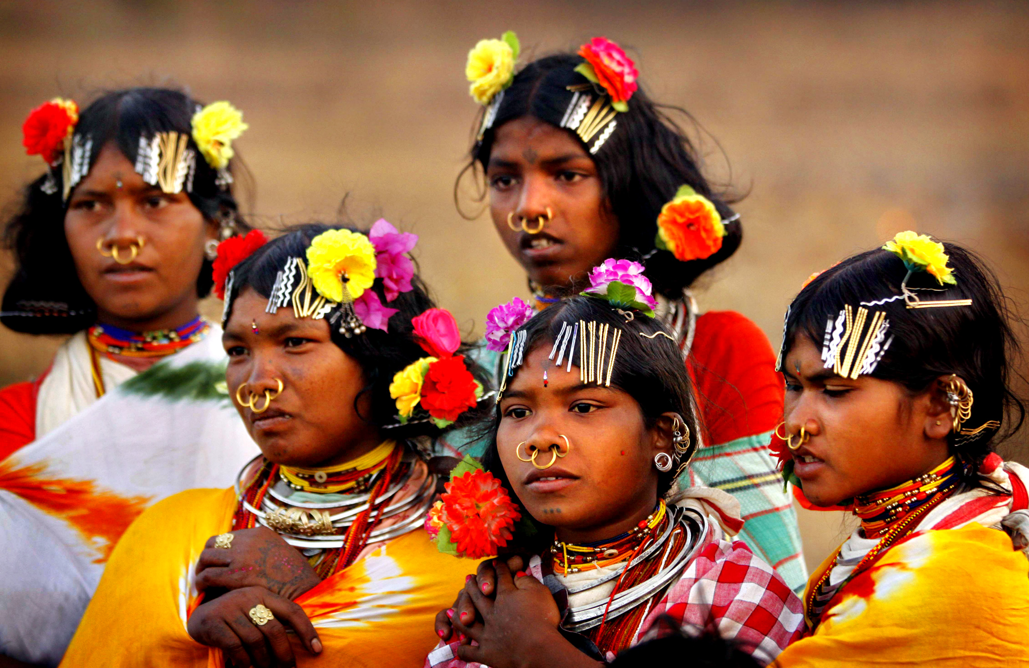 members of Indiaís Dongria tribe watch animal sacrifice during the two-day long Niyamraja Festival atop the Niyamgiri hills near Lanjigarh in Kalahandi district, Orissa state, India. Every year, members of this indigenous group celebrate this festival sacrificing animals and birds in worship of their deity. (AP Photo/Biswaranjan Rout)