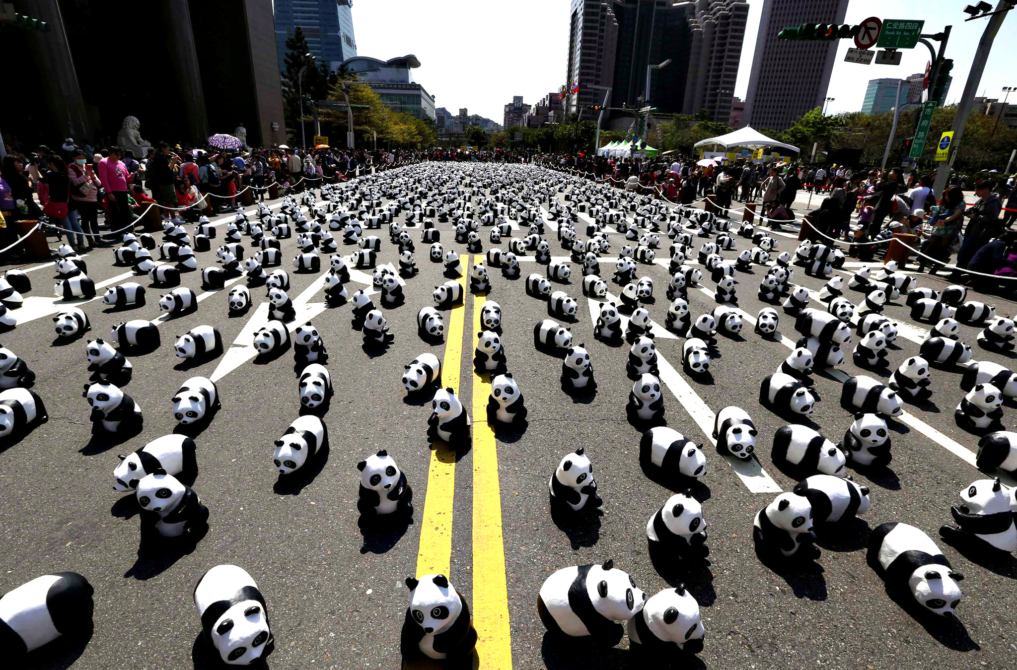 "Papier mache pandas, created by French artist Grangeon, are seen displayed outside Taipei City Hall as part of an exhibition called ""Pandas on Tour""...Papier mache pandas, created by French artist Paulo Grangeon, are seen displayed outside Taipei City Hall as part of an exhibition called ""Pandas on Tour"", February 28, 2014. According to local media, the event was launched by the World Wildlife Fund (WWF) first in Paris in 2008. Approximately 1,600 panda sculptures were displayed in the exhibition to remind people of the similar number of giant pandas still living in the wild and call on people's protection of endangered species. REUTERS/Patrick Lin (TAIWAN - Tags: ANIMALS SOCIETY ENVIRONMENT)"