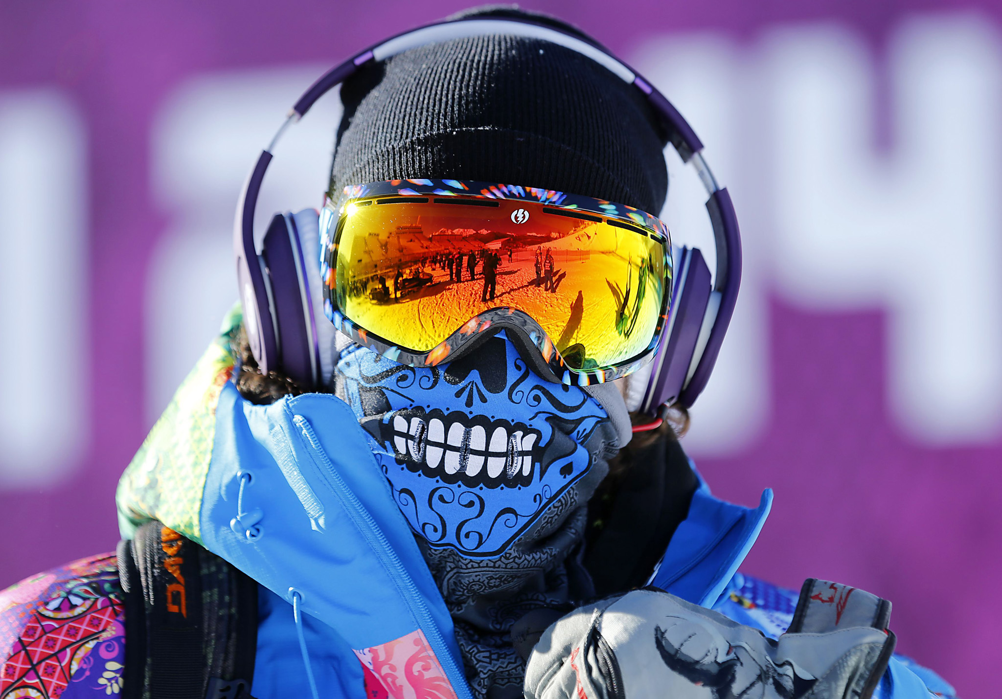 Course worker Svyatoslav Shirvel wears head phones and goggles during slopestyle snowboard training at the 2014 Sochi Winter Olympics in Rosa Khutor...Course worker Svyatoslav Shirvel wears head phones and goggles during slopestyle snowboard training at the 2014 Sochi Winter Olympics in Rosa Khutor February 3, 2014.    REUTERS/Mike Blake