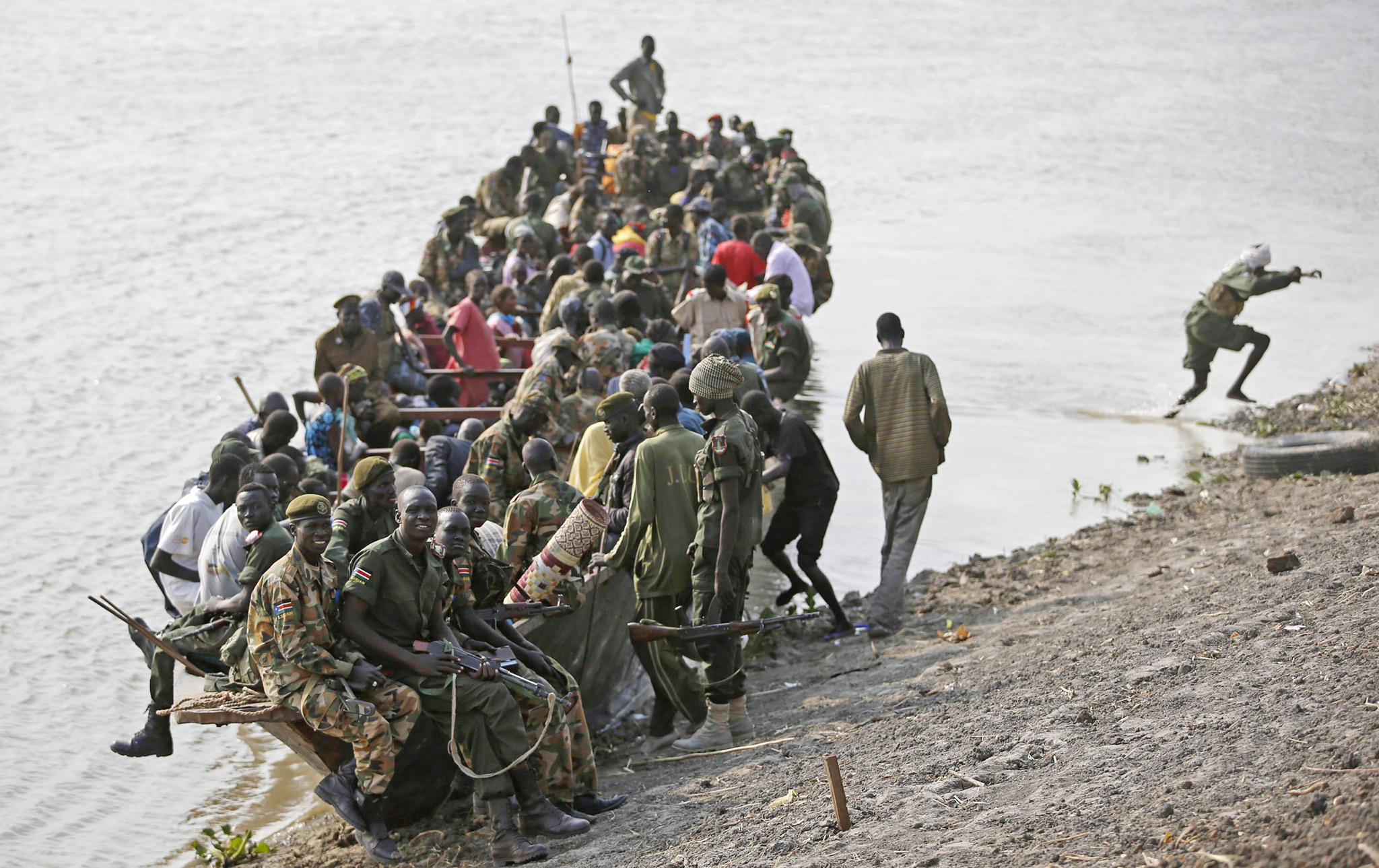 REUTERS PICTURE HIGHLIGHT...ATTENTION EDITORS - REUTERS PICTURE HIGHLIGHT TRANSMITTED BY 1335 GMT ON FEBRUARY 7, 2014    GOT10  Civilians and rebel fighters are seen on a boat in Sobat river in town of Ulang in Upper Nile State.