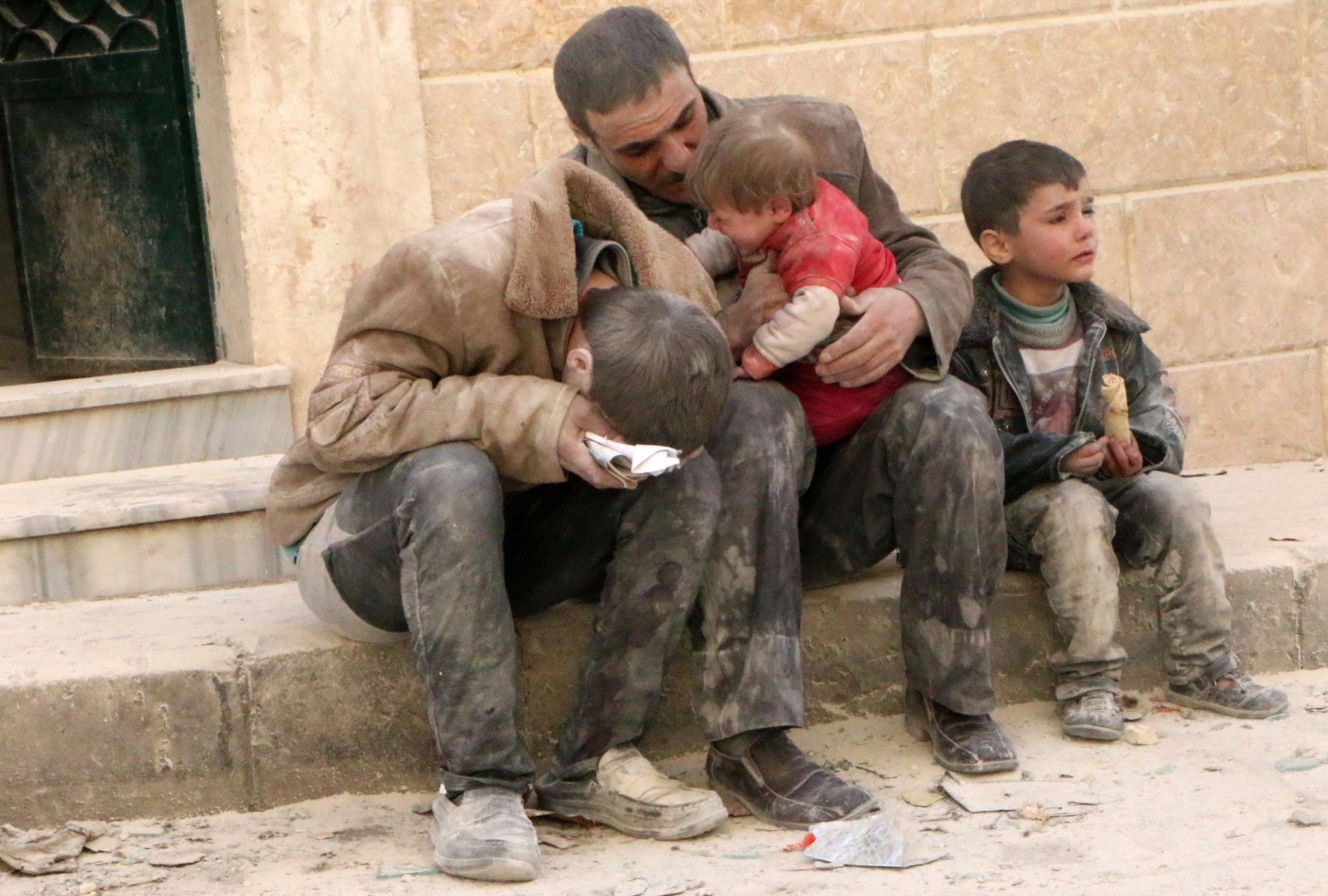 A man and three boys, covered with dust,...A man and three boys, covered with dust, sit in a state of shock following a reported air strike attack by government forces on the Hanano district of the northern Syrian city of Aleppo on February 14, 2014. Syria's warring sides began what was expected to be a decisive final day of talks in Geneva, amid warnings that they must at least agree an agenda to save the process.   AFP PHOTO/ALEPPO MEDIA CENTRE/FADI AL-HALABIFadi al-Halabi/AFP/Getty Images