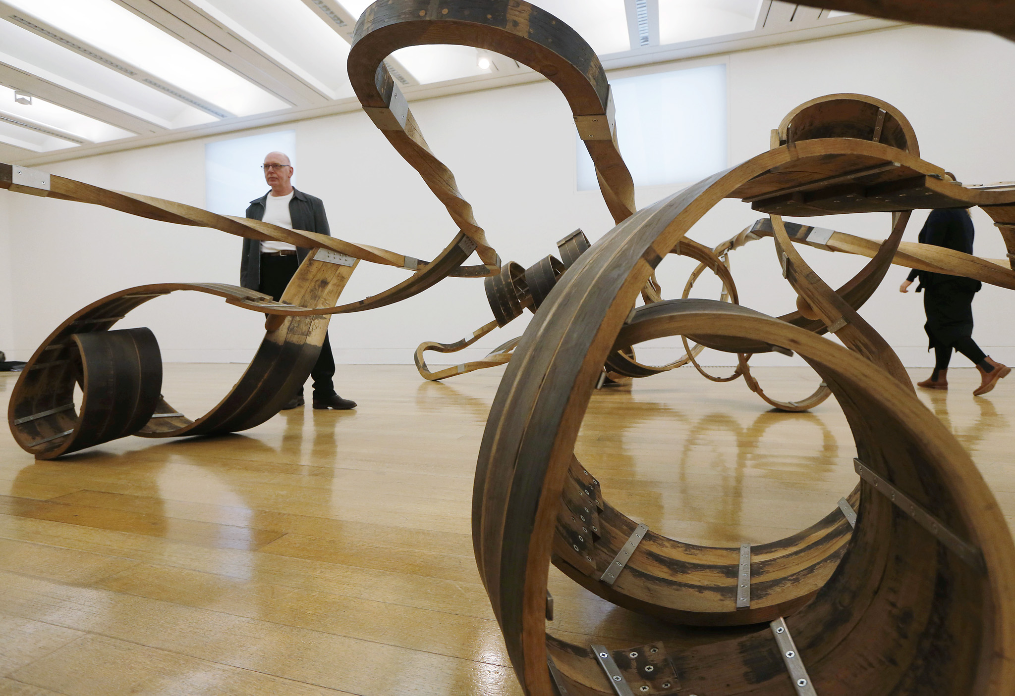 Richard Deacon...British artist and Turner Prize winner Richard Deacon poses with his sculpture 'Out of Order 2003' at Tate Britain art gallery in London during the launch of the exhibition of his artworks at the gallery, Monday Feb. 3, 2014.