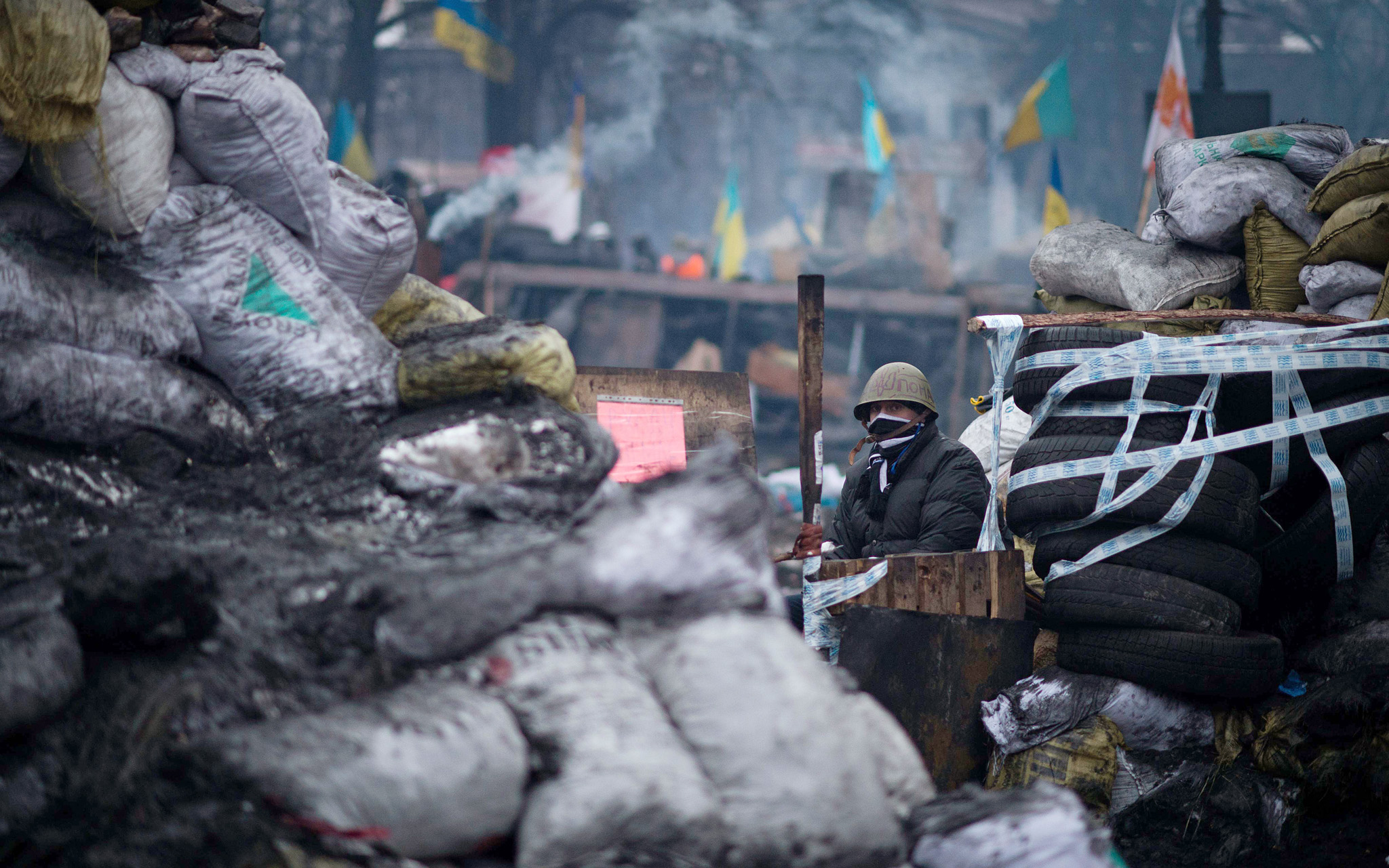 TOPSHOTS An anti-government protester st...TOPSHOTS An anti-government protester stands on a barricade in Kiev on February 7, 2014. Ukraine's unrest erupted in November 2013 after President Viktor Yanukovych rejected an association agreement with the European Union in favour of closer ties with Moscow, and the turmoil has now become an all-out movement to oust him. AFP PHOTO MARTIN BUREAUMARTIN BUREAU/AFP/Getty Images