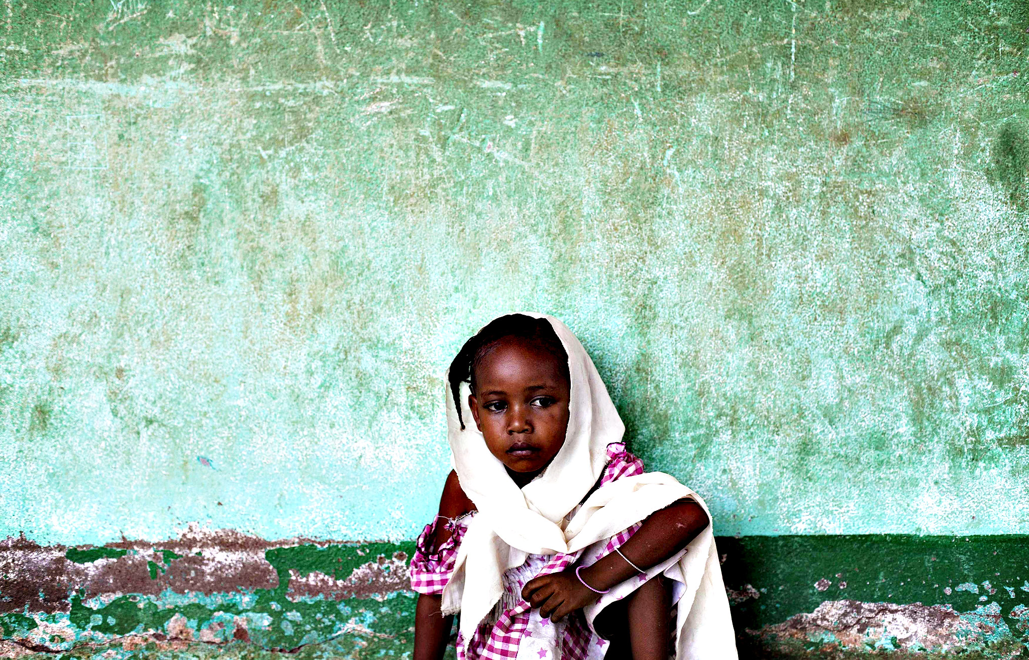"A Muslim girl takes refuge in a Koranic school in the majority Muslim neighbourhood ""5 Kilo,"" in Bangui, Central African Republic, February 24, 2014. About 50 Muslims are displaced in the school waiting to be moved to a safer location."