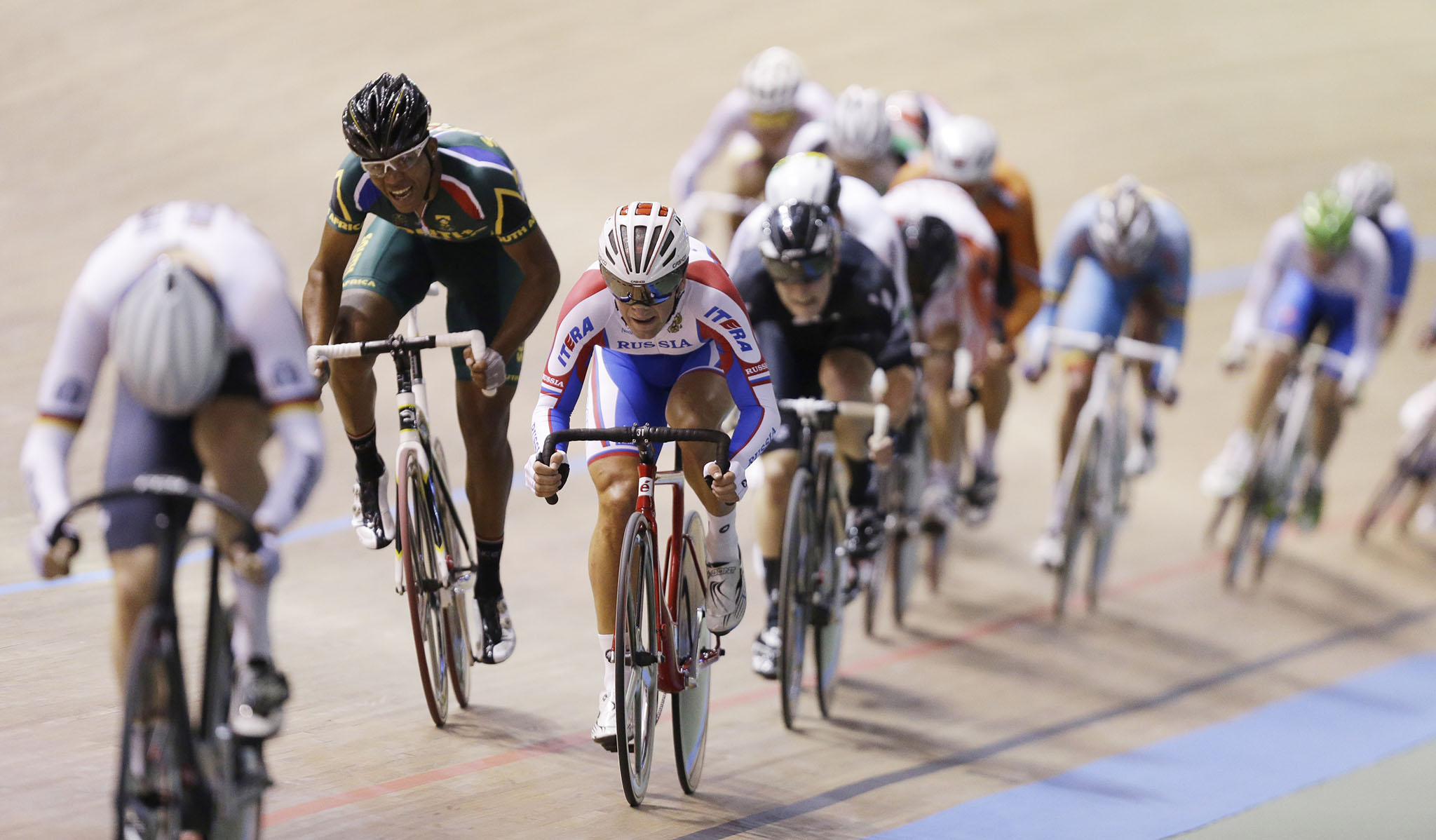 Russia's Ivan Kovalev, third from left, competes to win the gold in the men's scratch race at the Track Cycling World Championships in Cali, Colombia, Thursday, Feb. 27, 2014. (AP Photo/Fernando Vergara)