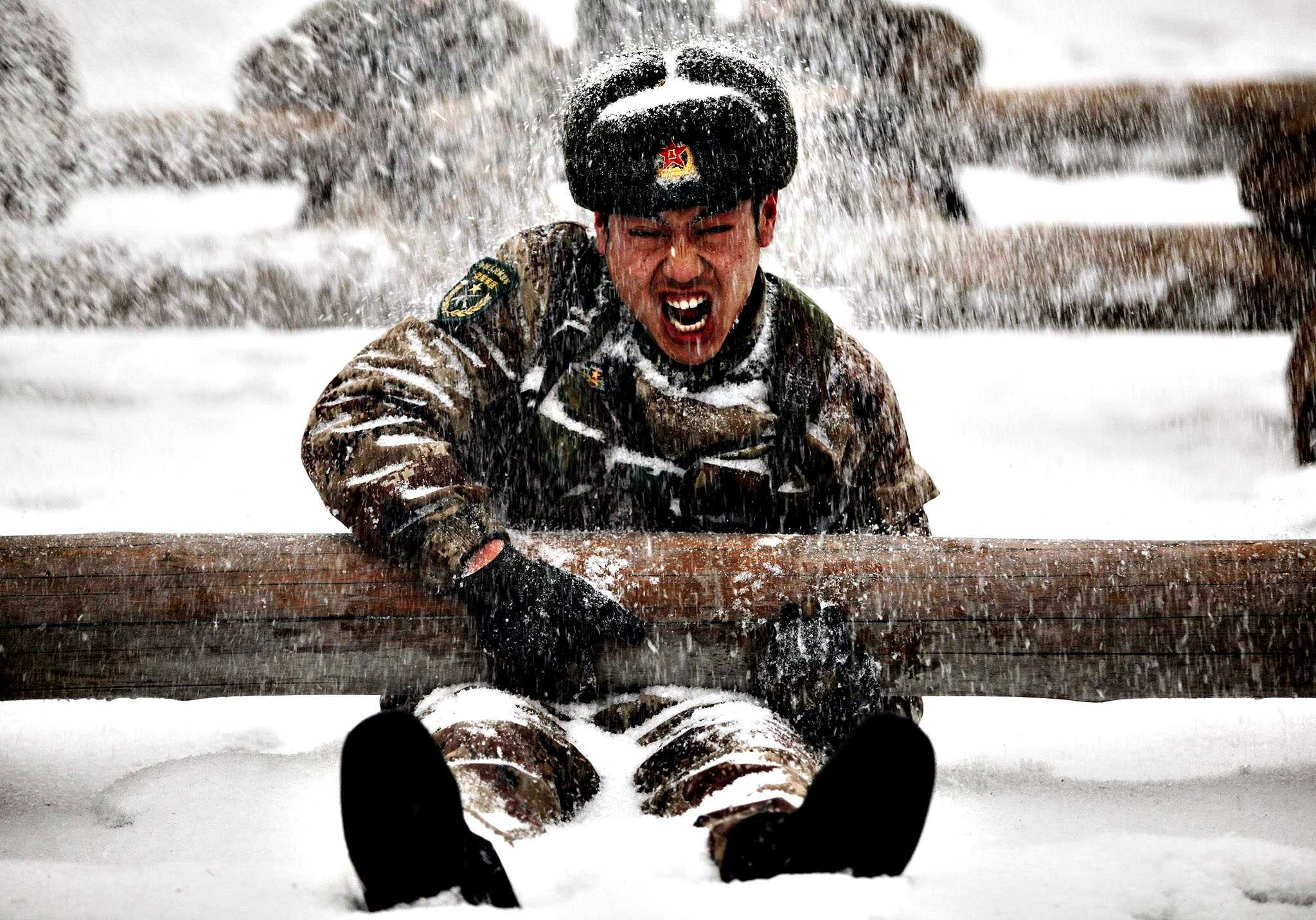 Soldiers take part in a drill during a heavy snow in Heihe, Heilongjiang province.