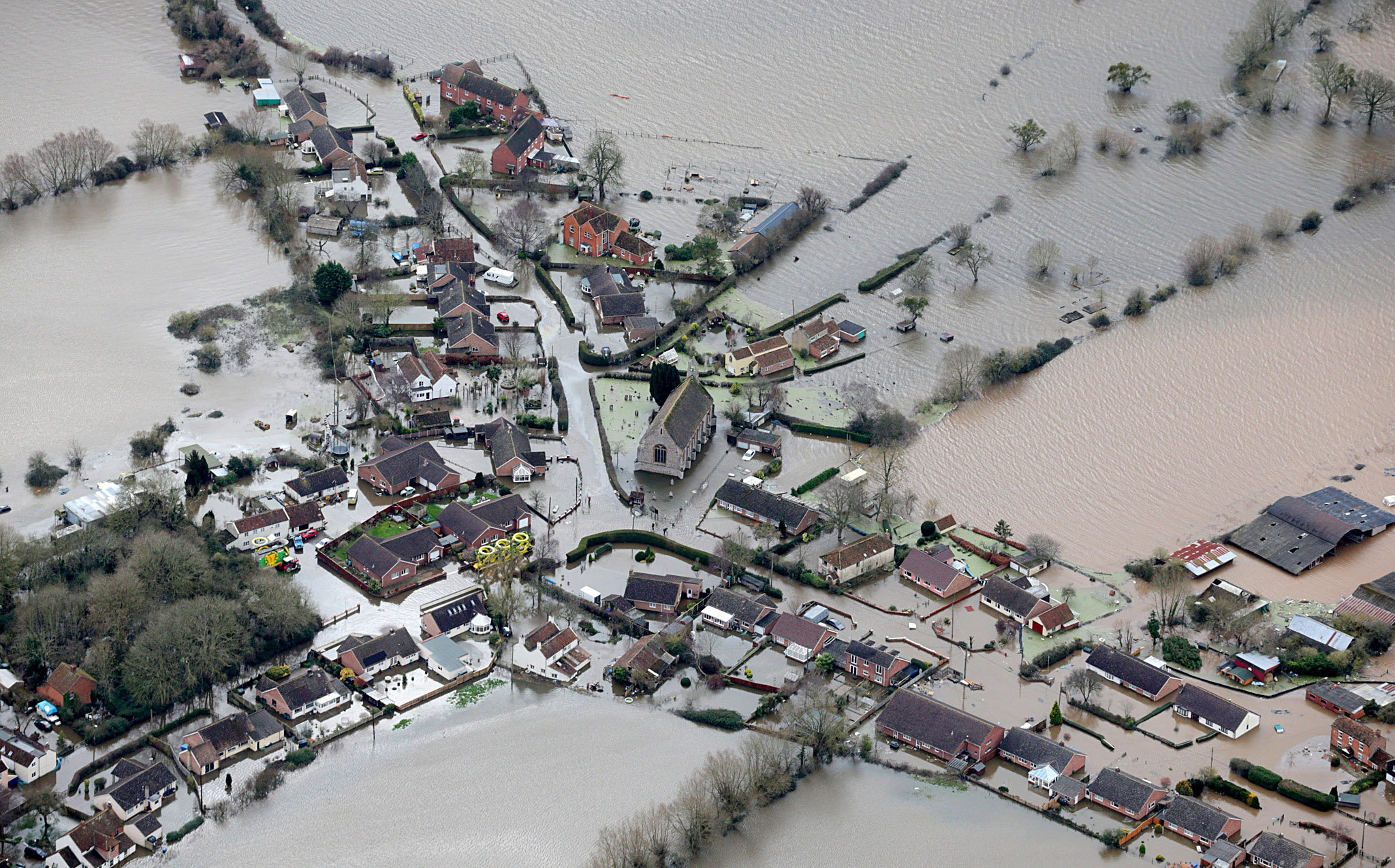 ***BESTPIX***  Aerial Views Show The Extent Of The Flooding On The Somerset Levels...BRIDGWATER, UNITED KINGDOM - FEBRUARY 10:  Water surrounds flooded properties in the village of Moorland on the Somerset Levels on February 10, 2014 in Somerset, England. Thousands of acres of the Somerset Levels have been under water for weeks, yet flood levels are still rising and worryingly, more rain is forecast for later this week.  (Photo by Matt Cardy/Getty Images) ***BESTPIX***
