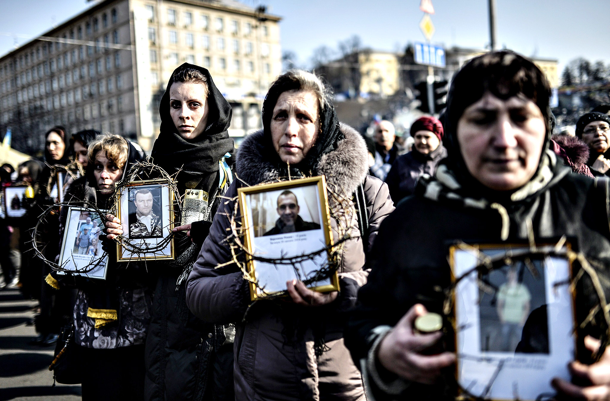 Women hold pictures of protesters who were killed in clashes with police during recent demonstrations as they take part in a commemerative procession in central Kiev on February 26, 2014. Ukraine's pro-Western interim leaders were set to unveil their new cabinet today after disbanding the feared riot police as they sought to build confidence in the splintered and economically ravaged ex-Soviet nation.