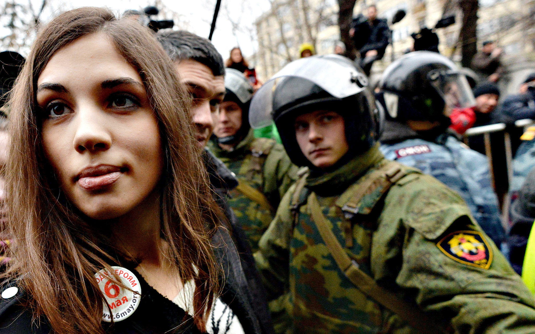 Russian punk group Pussy Riot member Nadezhda Tolokonnikova looks on as she stands outside Zamoskvoretsky district court in Moscow, on February 24, 2014, during a protest against the trial of eight people accused of instigating mass riots after an opposition rally on Moscow's on Bolotnaya square turned violent on the eve of Vladimir Putin's inauguration as president in 2012. A Russian court resumed today the sentencing of the eight anti-Putin protesters found guilty of mass riots as police detained dozens of people protesting against the trial.