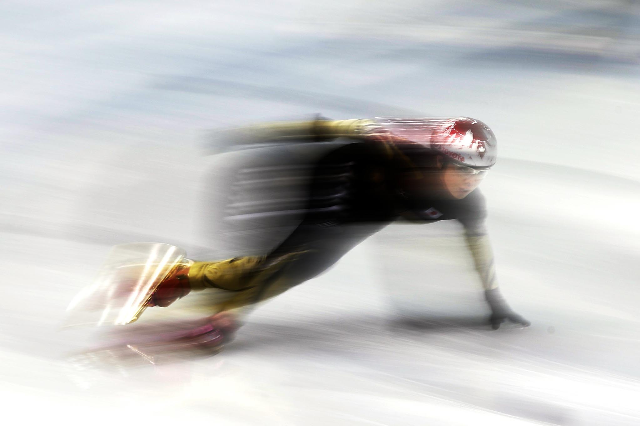 A member of Japan's short track speed skating team skates during a training session in preparation for the 2014 Sochi Winter Olympics at the Iceberg Skating Palace