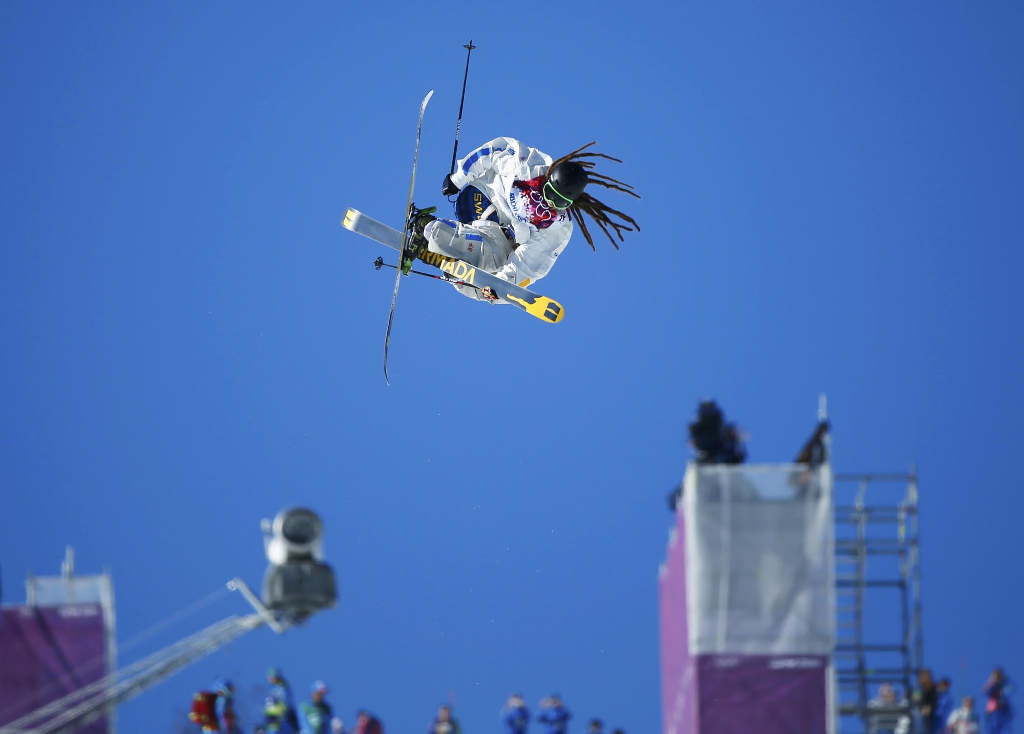 Sweden's Henrik Harlaut performs jump during men's freestyle skiing slopestyle finals at 2014 Sochi Winter Olympic Games in Rosa Khutor