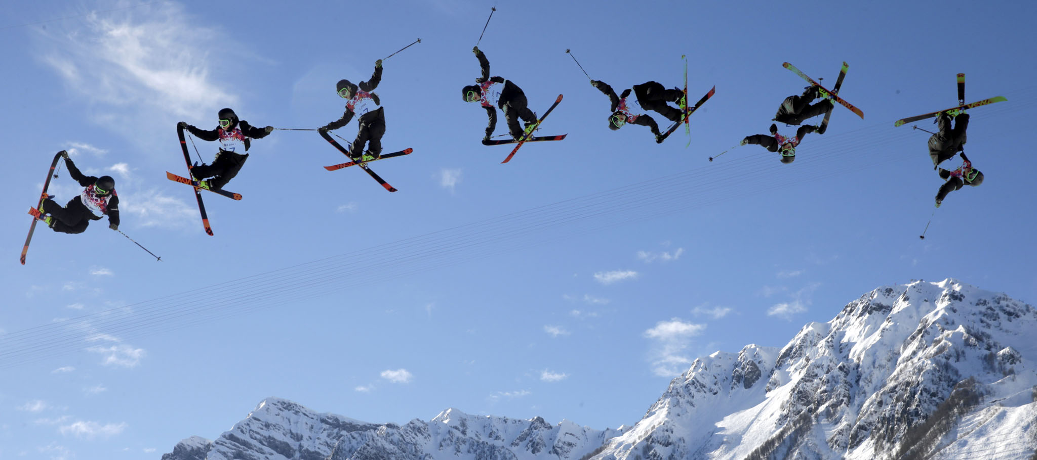 Antti Ollila...In this image made with a multiple exposure, Finland's Antti Ollila competes in the men's ski slopestyle qualifying at the Rosa Khutor Extreme Park during the 2014 Winter Olympics, Thursday, Feb. 13, 2014, in Krasnaya Polyana, Russia. (AP Photo/Gero Breloer)