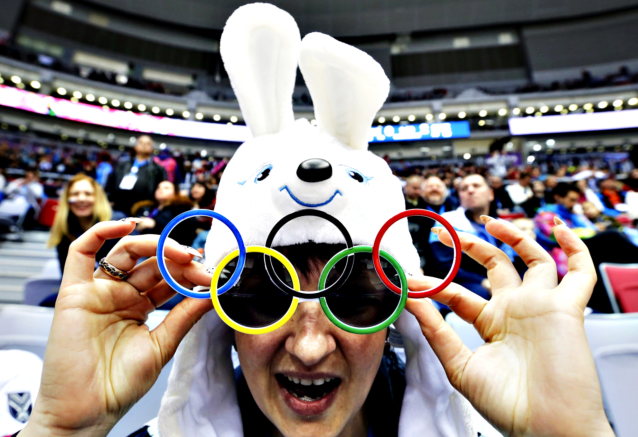 A fan wears sunglasses in the shape of the Olympic rings during the women's ice hockey bronze medal game between Sweden and Switzerland at the Sochi 2014 Winter Olympic Games...A fan wears sunglasses in the shape of the Olympic rings during the women's ice hockey bronze medal game between Sweden and Switzerland at the Sochi 2014 Winter Olympic Games February 20, 2014.