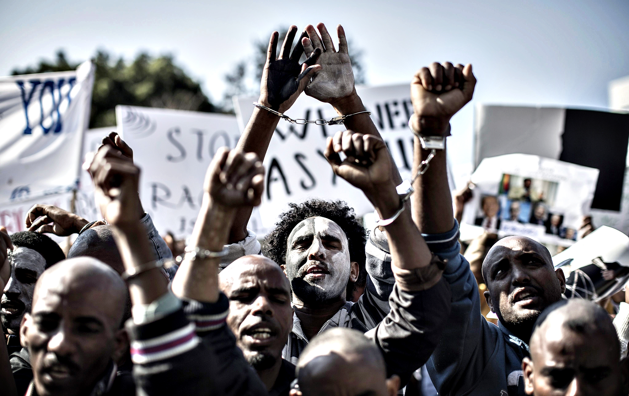 African asylum seekers gesture during a protest outside the Ministry of Interior in Tel Aviv, Israel, 11 February 2014. Over 1,000 African migrants, which mostly arrive from Eritrea and Sudan, marched from southern Tel Aviv's Levinski Park to the Ministry of Interior. The asylum seekers are protesting since weeks  against Israel's refusal to grant them refugee status and the opening of 'Holot', the new detention facility in the country's south.