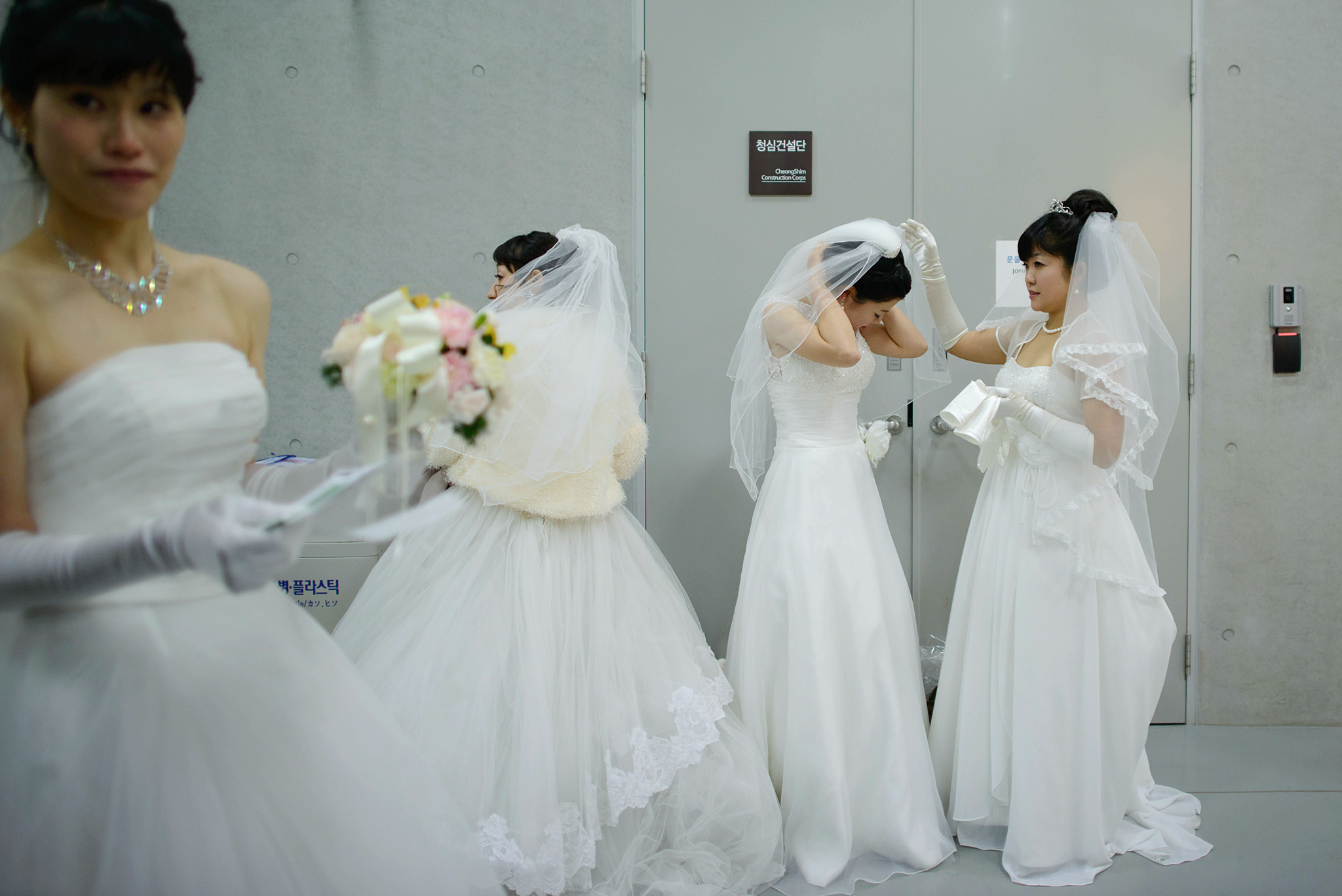 "Brides prepare for a mass wedding at an ...Brides prepare for a mass wedding at an event held by the Unification Church in Gapyeong on February 12, 2014. Unification Church members forming 2500 couples from 52 countries were married in a mass wedding in South Korea -- only the second such event since the death of their ""messiah"" and controversial church founder Sun Myung Moon."