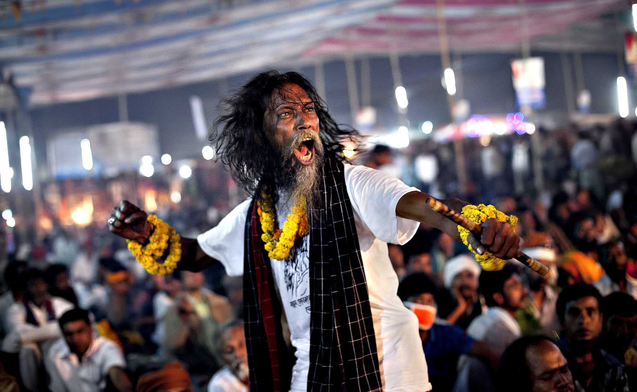 "A festival goer dances during a live music event during the 124th annual Lalon festival in Kushtia, Bangladesh. The Lalon Shah festival is an annual festival celebrating the life and death of Fakir Lalon Shah, who was a Bangladeshi mystic, baul, philosopher, musician, writer and advocate of religious tolerance. Buddhists, Hindus and Muslims follow his teachings and attend the festival, which comprises of 3 days of music, dance, and consumption of marijuana, which is referred to as ""siddhi"", or enlightenment."