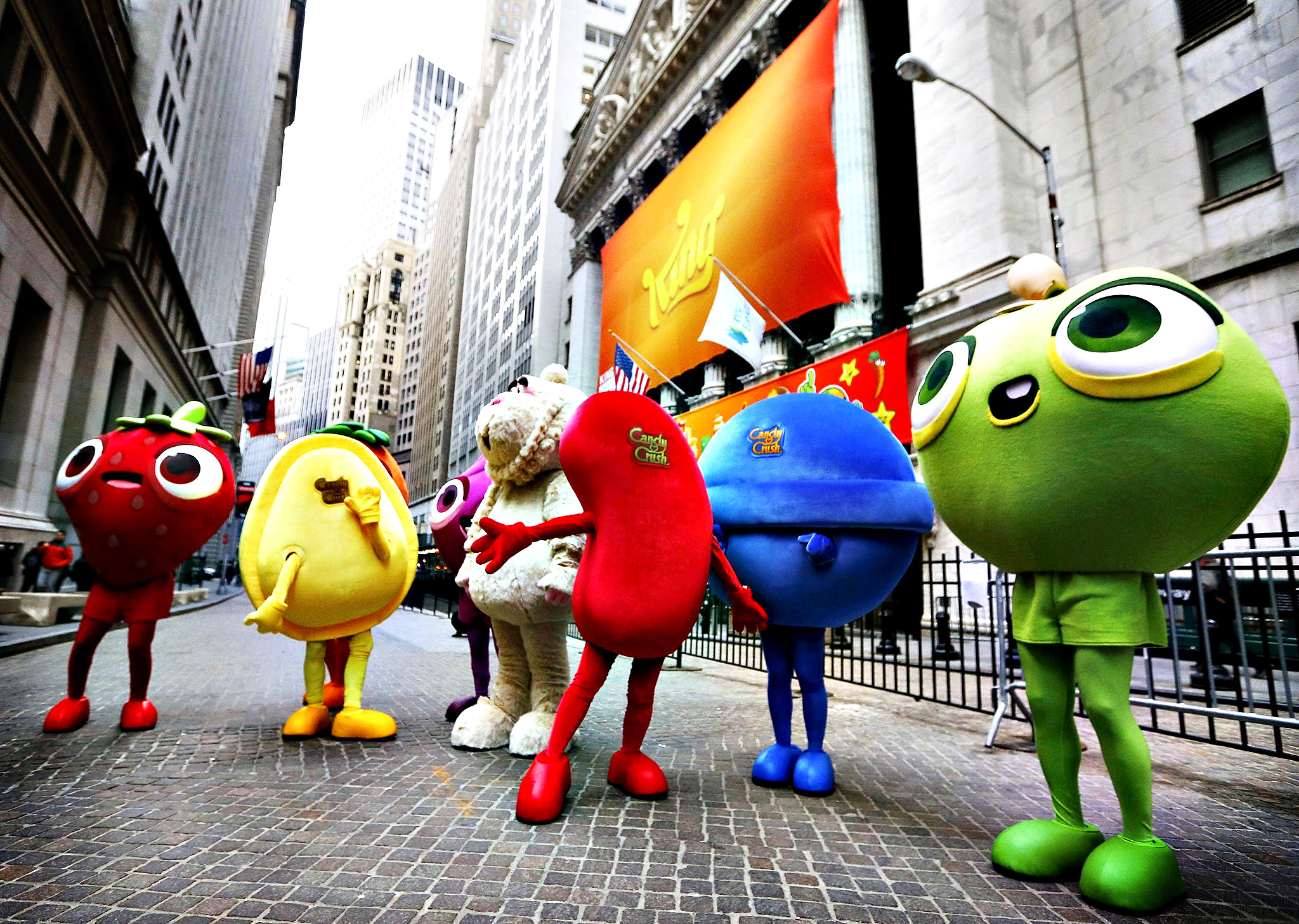 "Mascots dressed as characters from the mobile video game ""Candy Crush Saga"" pose outside the New York Stock Exchange ahead of the IPO of Mobile game maker King Digital Entertainment Plc  March 26, 2014."