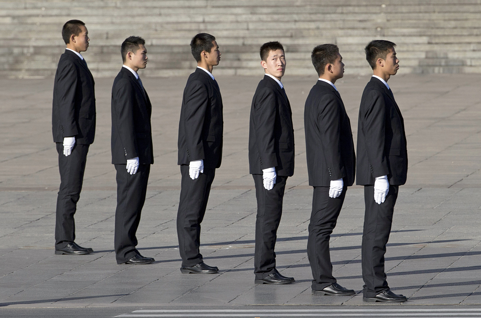 Chinese security personnel form up before the arrival of delegates at the Great Hall of the People to attend sessions of National People's Congress and Chinese People's Political Consultative Conference in Beijing, China, Tuesday, March 4, 2014