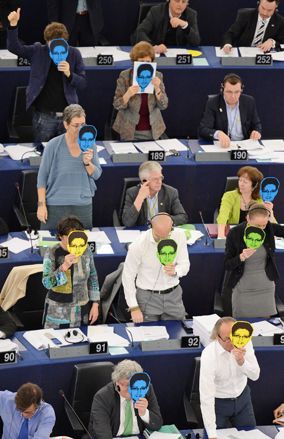 European Parliament Session in Strasbourg...epa04121356 Members of the European Parliament for Alliance 90/The Greens wear paper masks depicting US whistleblower and former NSA employee Edward Snowden as they vote during the plenary session at the European Parliament in Strasbourg, France, 12 March 2014. The politicians voted against the NSA surveillance programme of the USA, surveillance bodies in various Member States and impact on EU