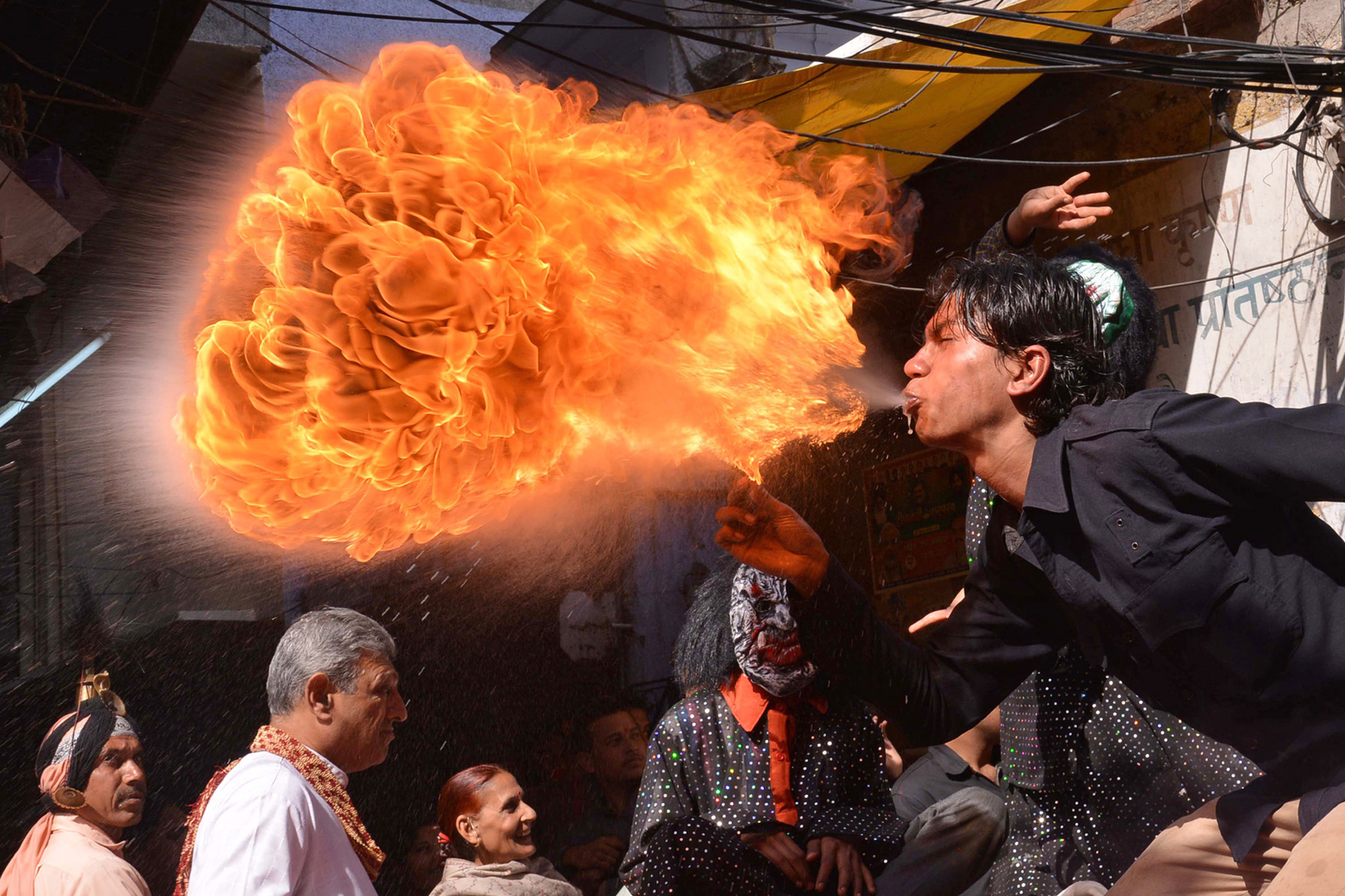 An Indian Hindu devotee performs with fi...An Indian Hindu devotee performs with fire as he participates in a procession ahead of the Holi festival in Amritsar on March 12, 2014. Holi, the popular Hindu spring festival of colours is observed in India at the end of the winter season on the last full moon of the lunar month and will be celebrated on March 16 this year. AFP PHOTO/NARINDER NANUNARINDER NANU/AFP/Getty Images