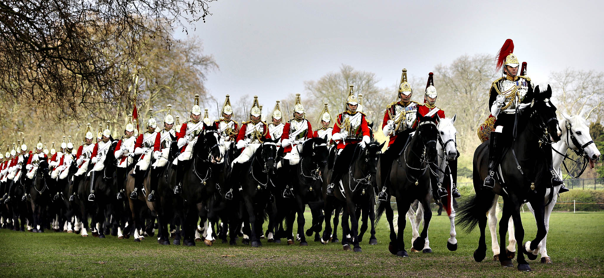 The Household Cavalry Mounted Regiment parades in Hyde Park in London, Thursday, March 20, 2014. The regiment was undergoing their annual inspection to validate their ability to conduct state ceremonial duties for the year. 160 horses were paraded accompanied by the mounted Band of the Life Guards and Band of the Blues and Royals.