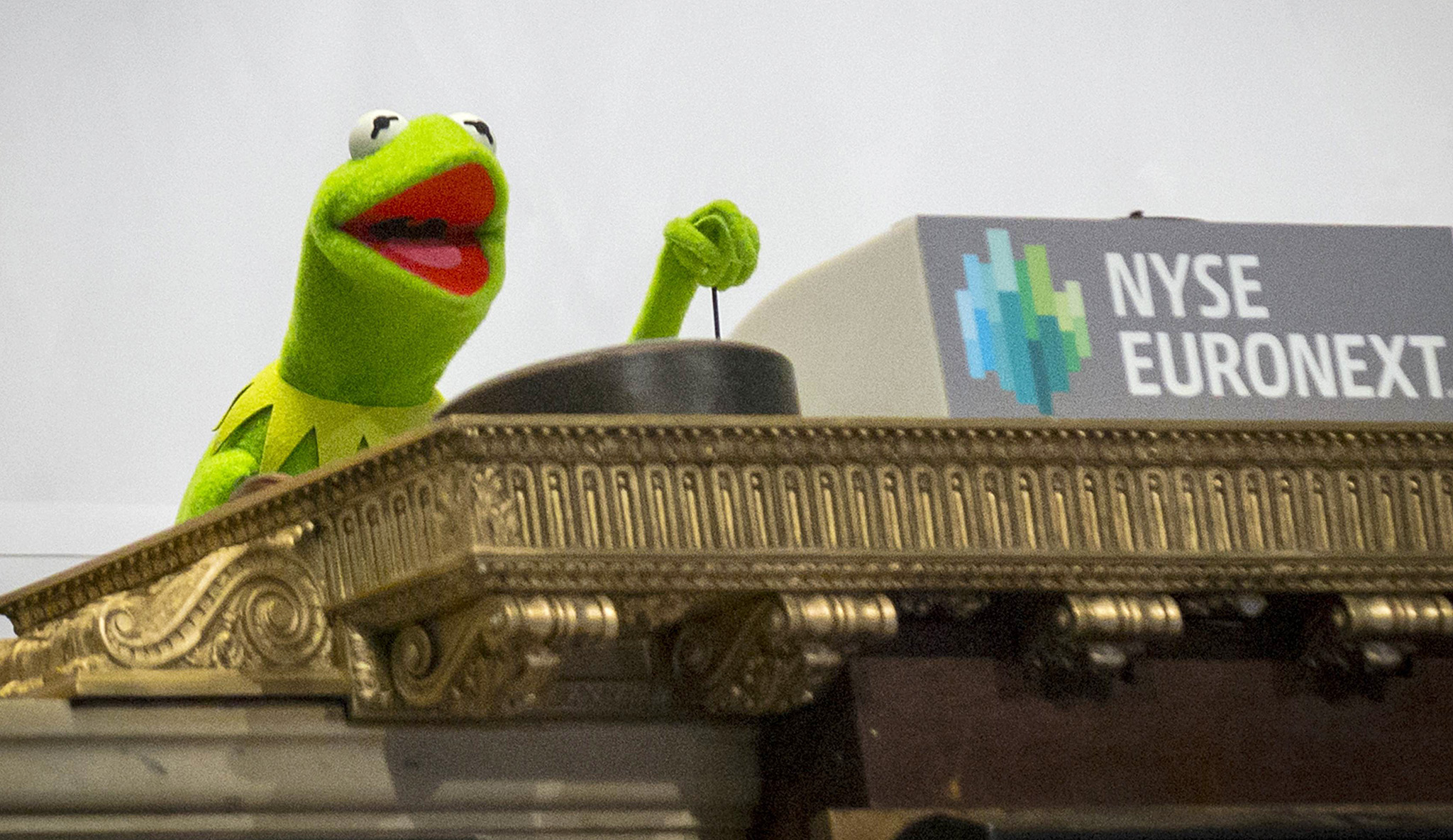 "Muppet Kermit the Frog rings the opening bell at the New York Stock Exchange...Muppet Kermit the Frog rings the opening bell at the New York Stock Exchange March 17, 2014.  Kermit rang the bell to celebrate Disney's new movie ""Muppets Most Wanted."" REUTERS/Brendan McDermid (UNITED STATES - Tags: ENTERTAINMENT)"